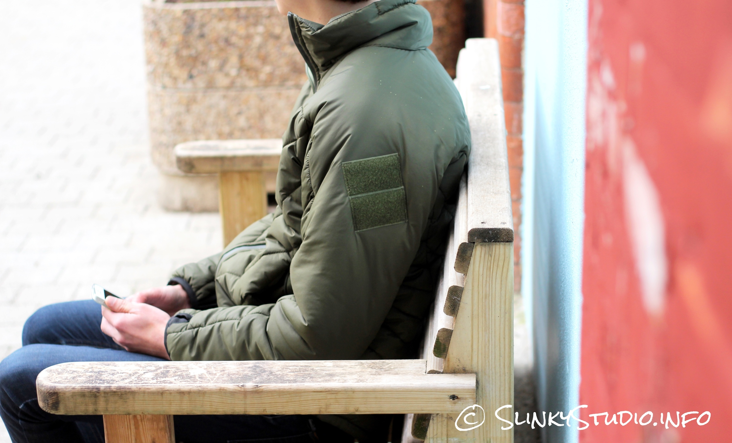 Snugpak SJ6 Jacket Sitting on Wooden Bench.jpg