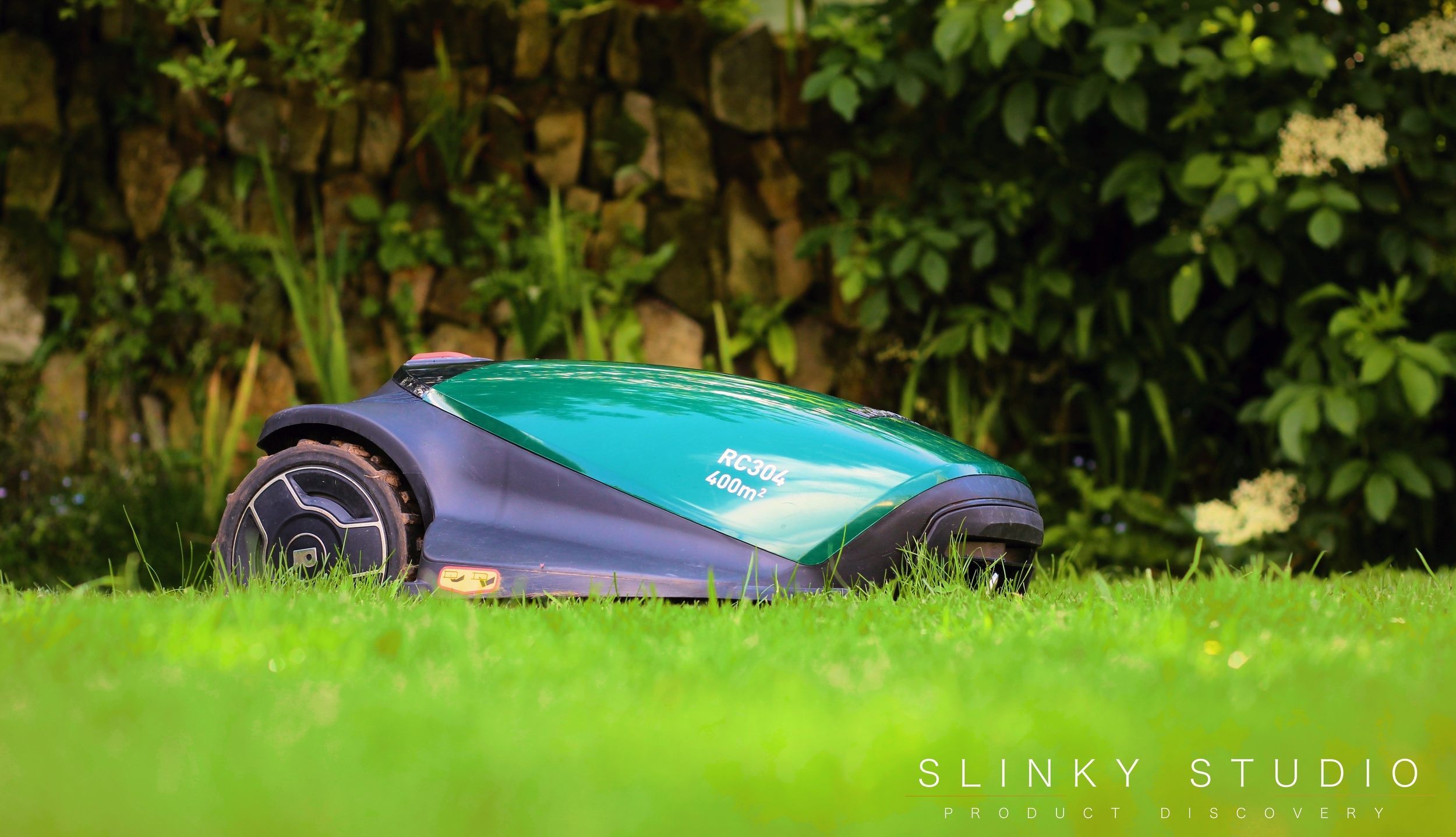Robomow RC304 Robot Lawnmower Mowing Lawn Side View.jpg