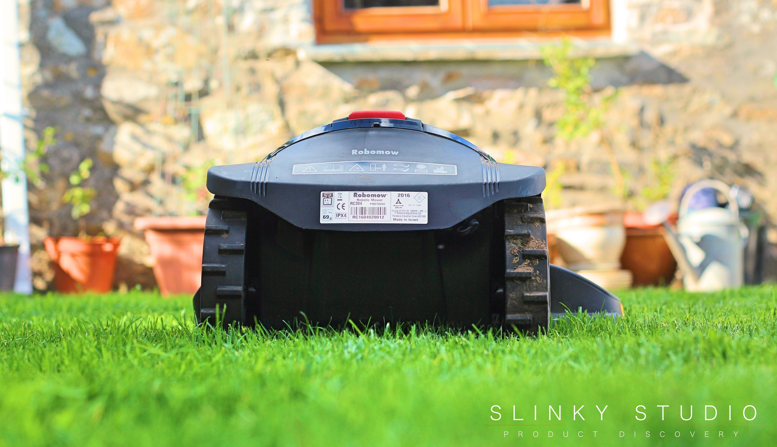 Robomow RC304 Robot Lawnmower Mowing Behind View.jpg
