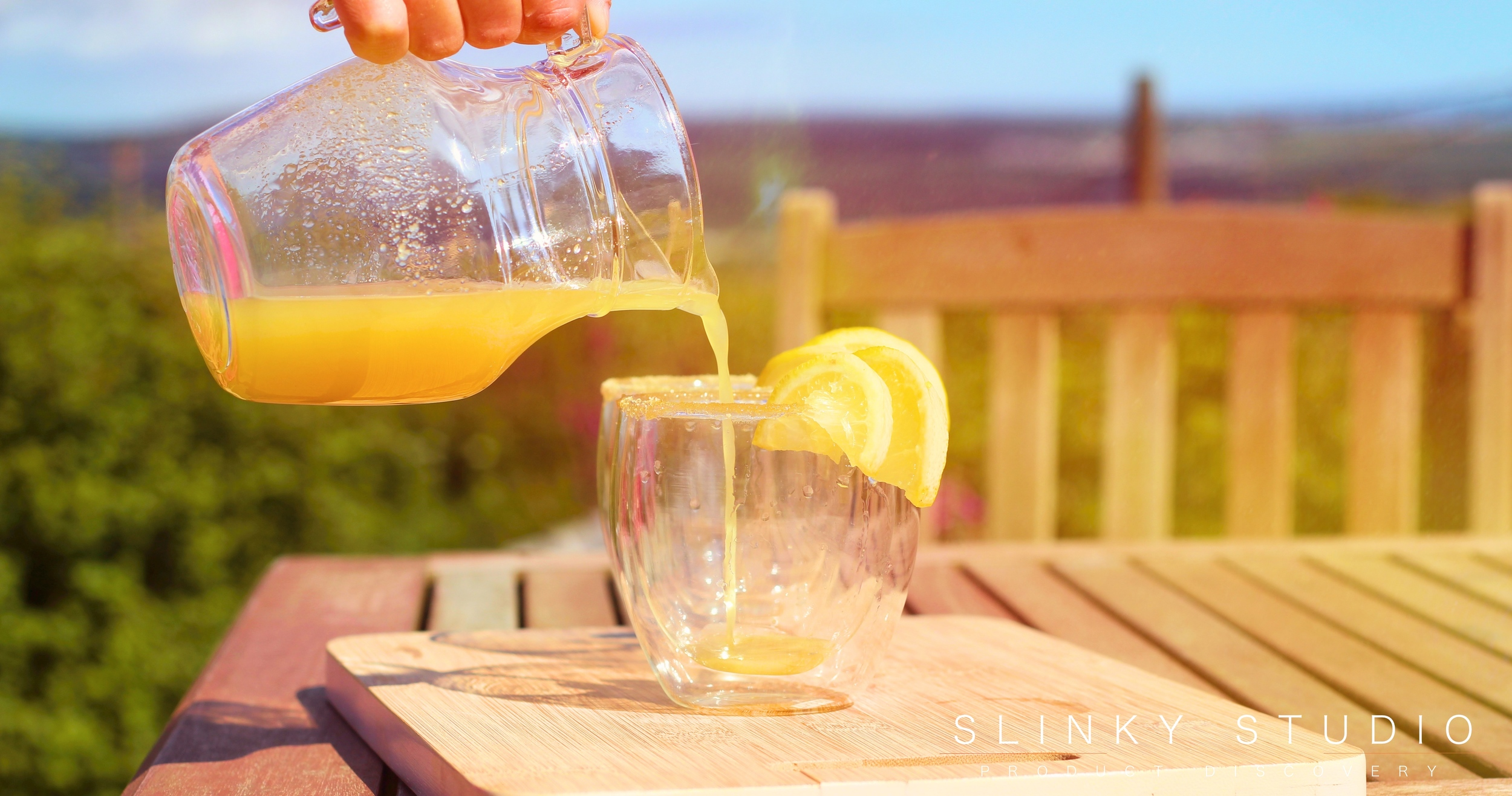 Optimum ThermoCook Ginger Beer Being Poured On Bench in Sun.jpg