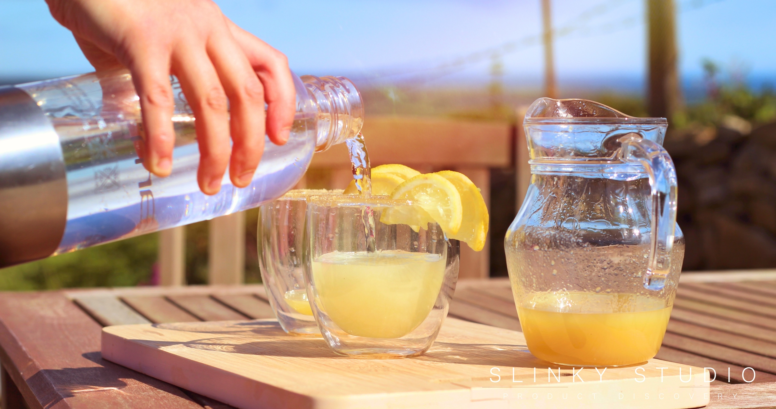 Optimum ThermoCook Ginger Beer SodaStream Being Poured On Bench in Sun.jpg