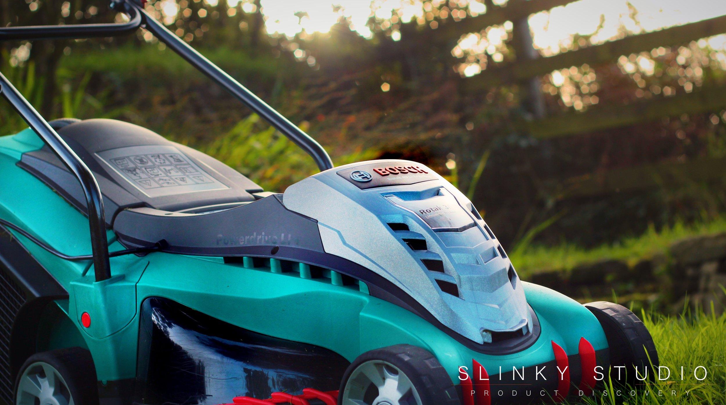 Bosch Rotak 43 LI Ergoflex Cordless Lawnmower Dusk Lighting Through Fence.jpg