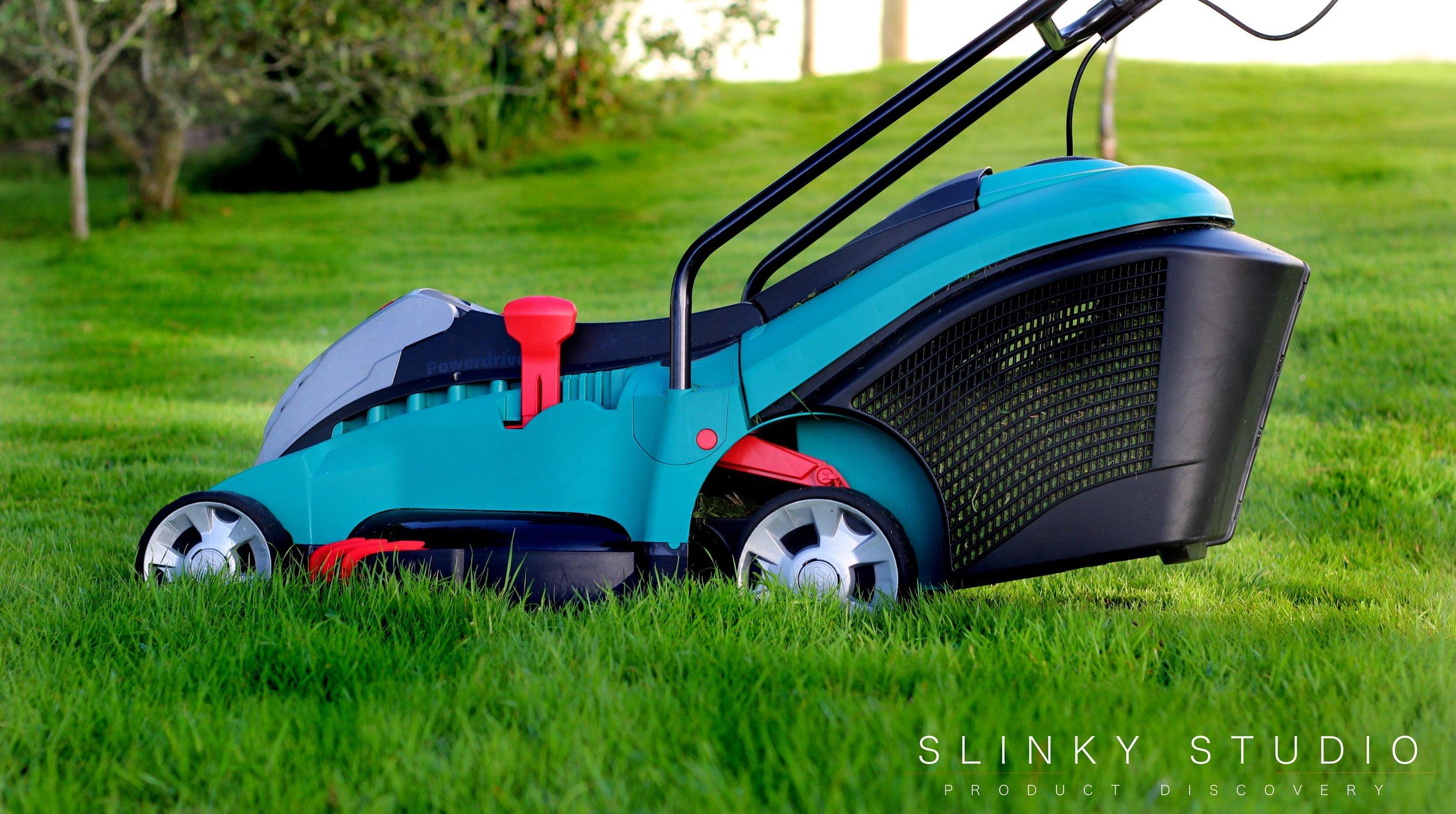 Bosch Rotak 43 LI Ergoflex Cordless Lawnmower Side View Mowing.jpg