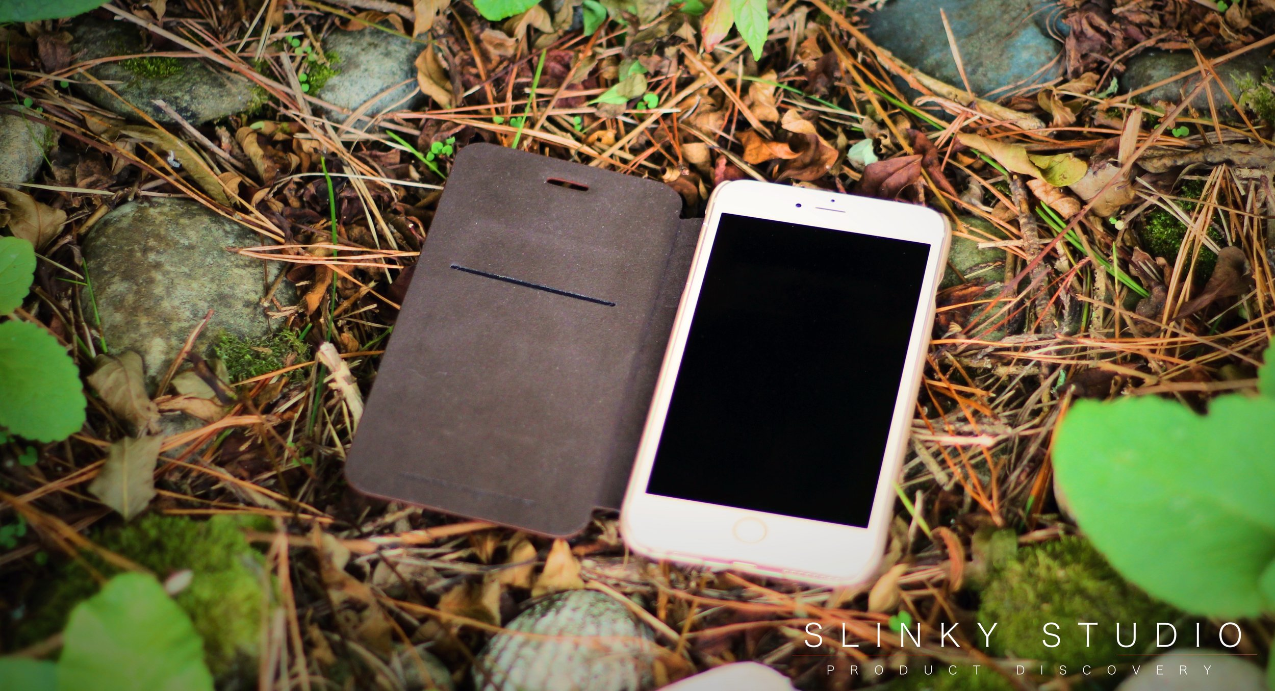 Elago Leather Flip Case for iPhone 6:6s Plus Open Lying on Fallen Pine Needles.jpg