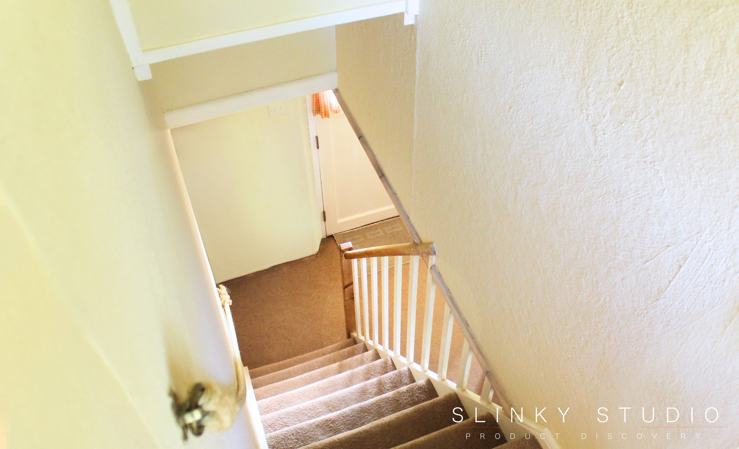 Farow & Ball Farrow's Cream (No.67) Estate Emulsion Looking Down Stairs in Hallway.jpg
