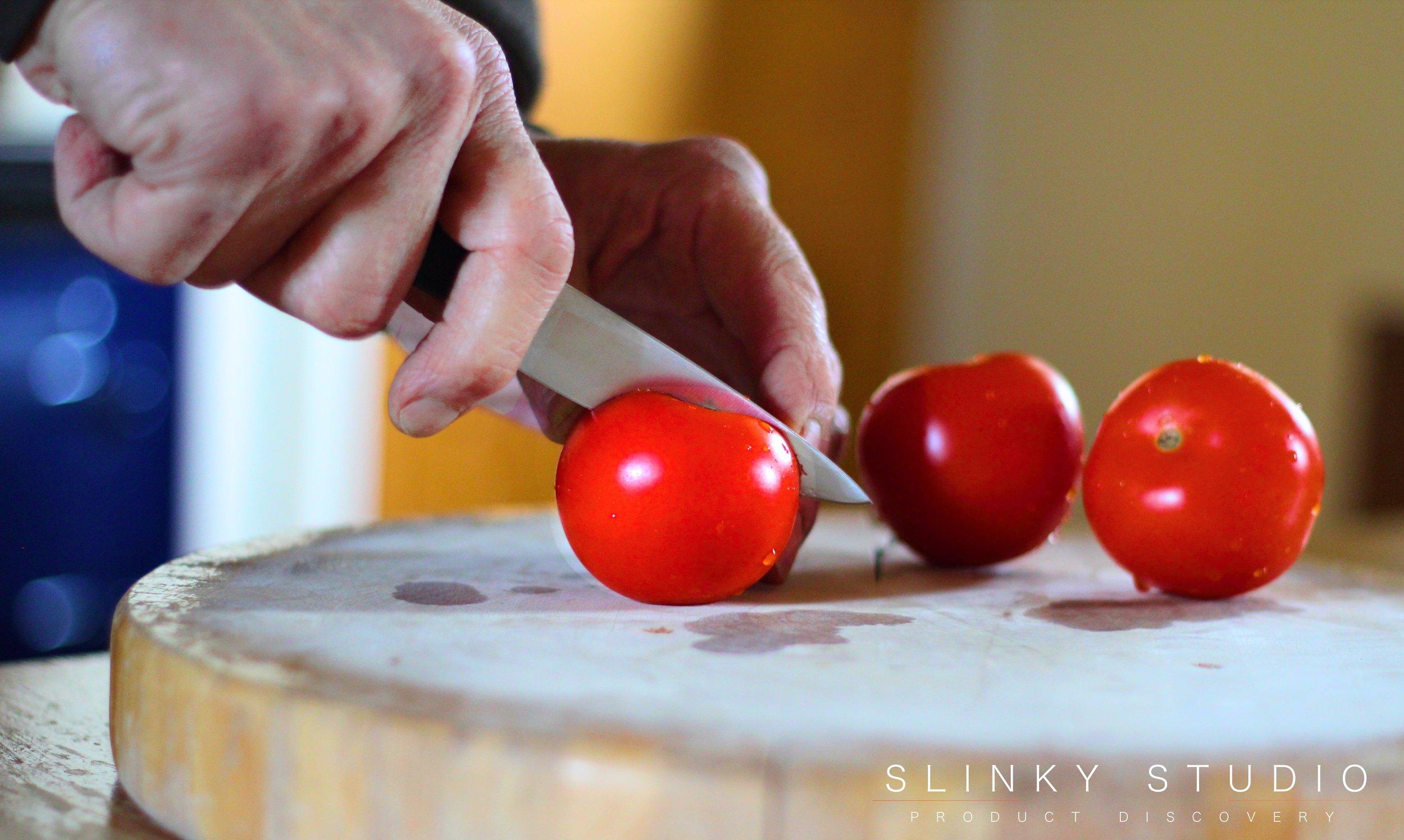 KitchenAid 7pc Professional Series Knife Set Pairing Knife Slicing Tomatoes.jpg