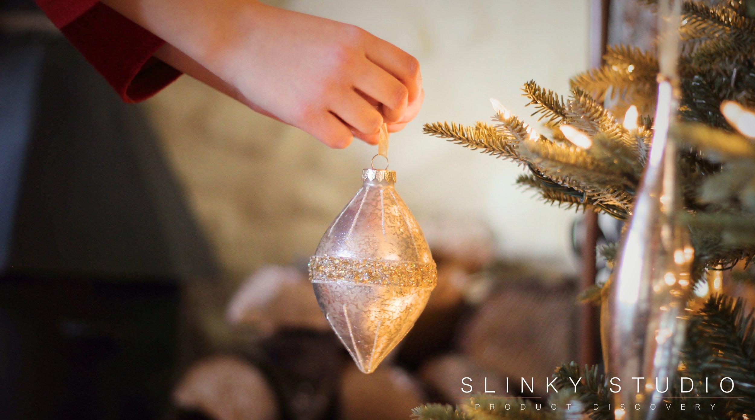 Balsam Hill Fraser Fir Christmas Tree Putting Ornament Decoration on Branch.jpg