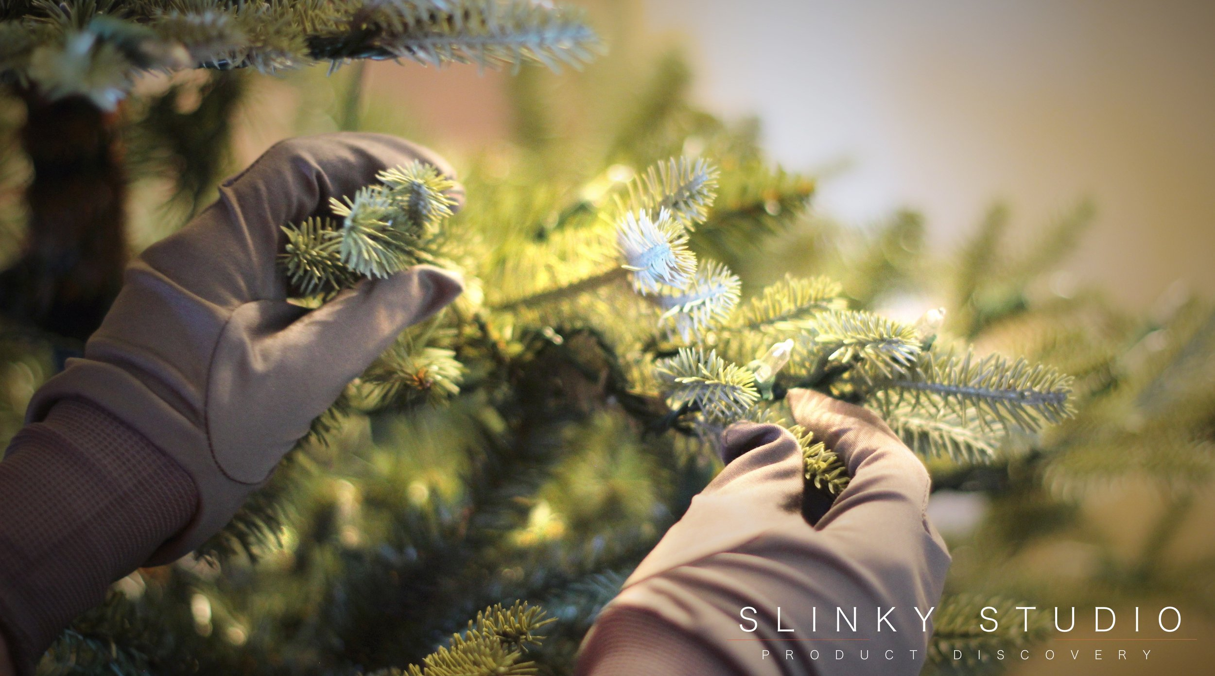 Balsam Hill Fraser Fir Christmas Tree Shaping Branches with Gloves on.jpg
