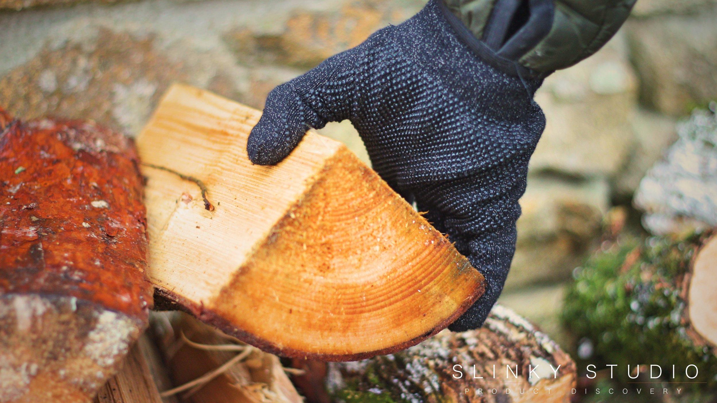 Mujjo Touchscreen Gloves Picking up Log.jpg