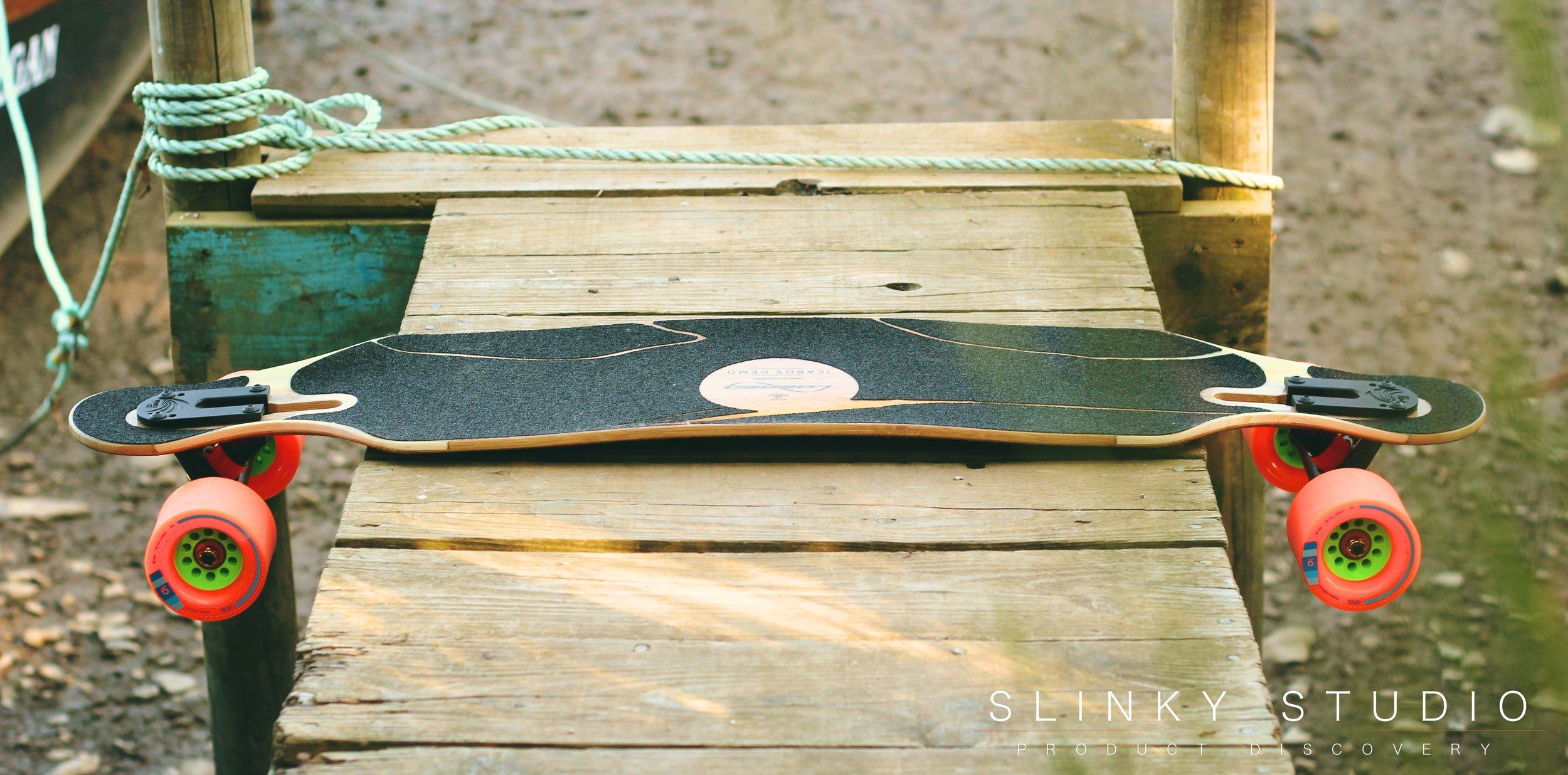 Loaded Icarus Longboard Lying on Wooden Peer