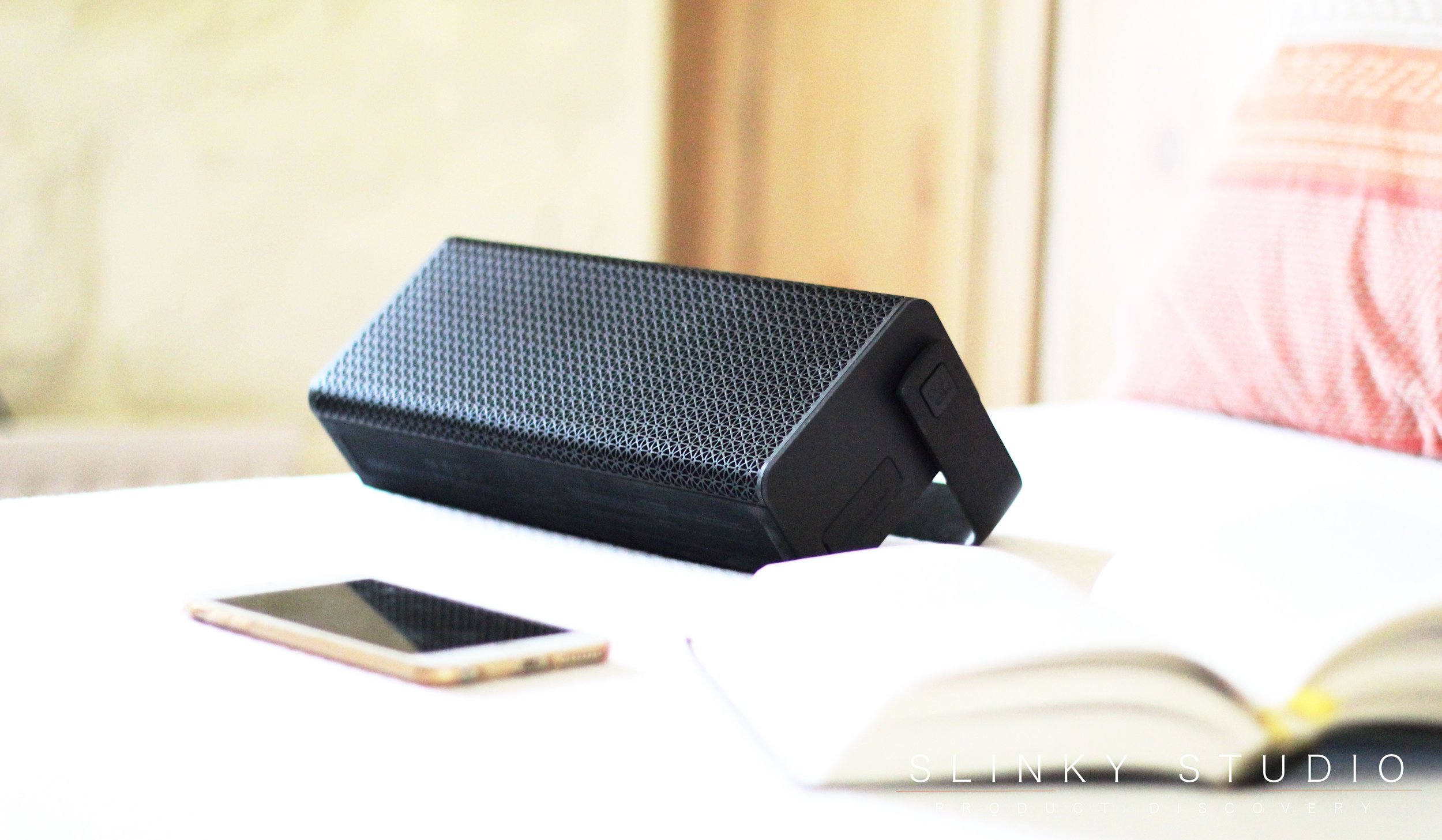 Edifier Rave MP700 Speaker on bed with book.jpg
