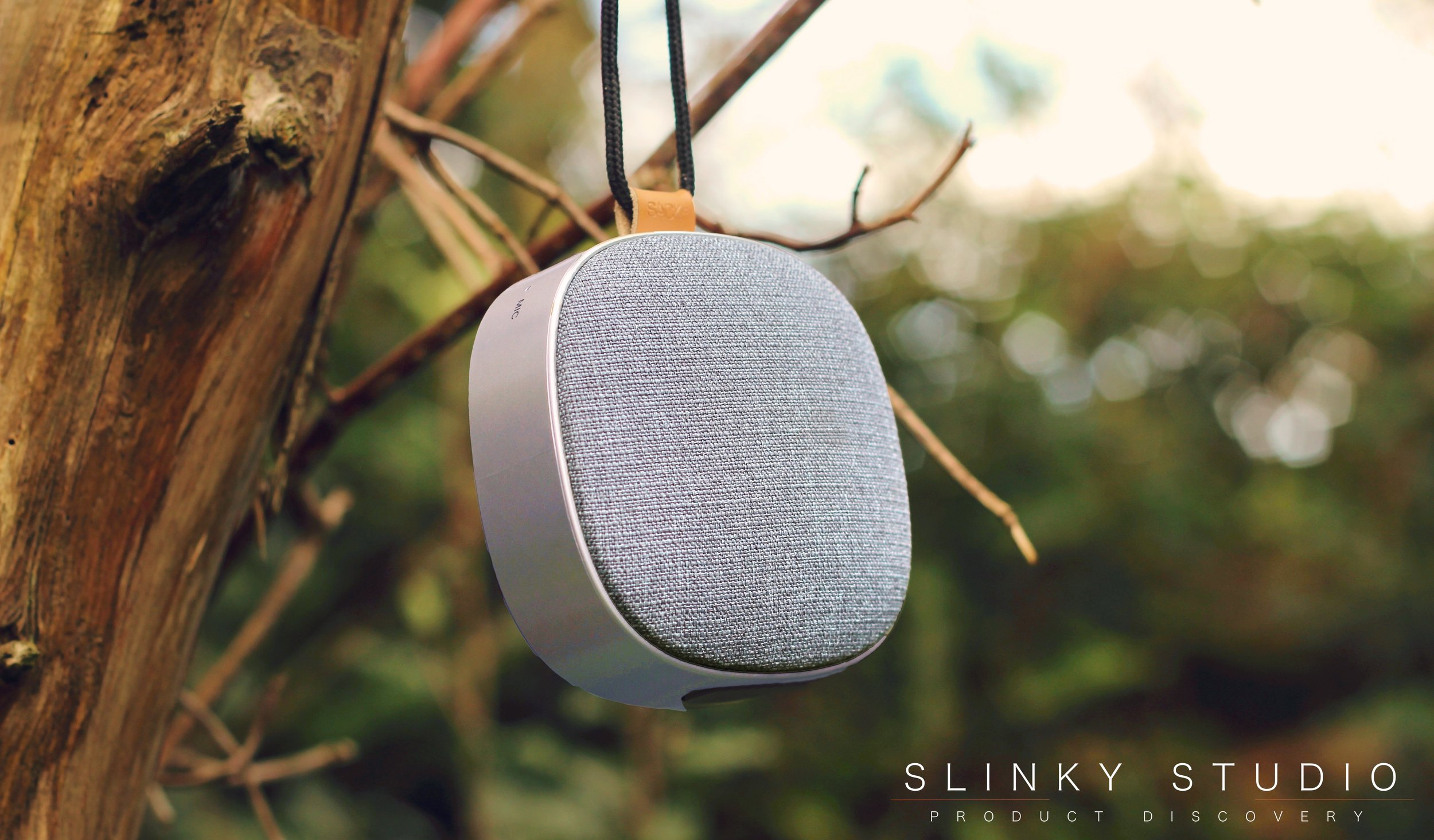 SACKit WOOFit Go Speaker Hanging from tree branch.jpg