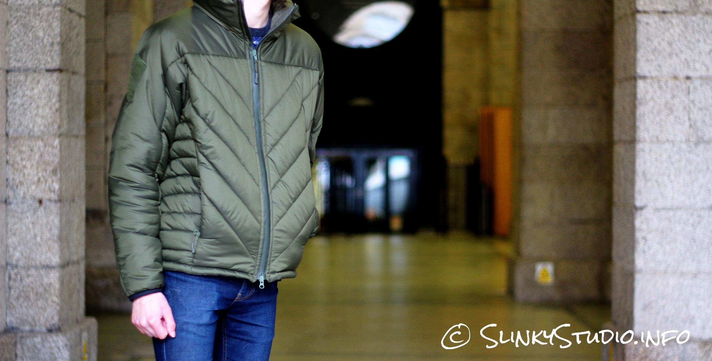Snugpak SJ6 Jacket Hand in Pocket Leaning Train Station