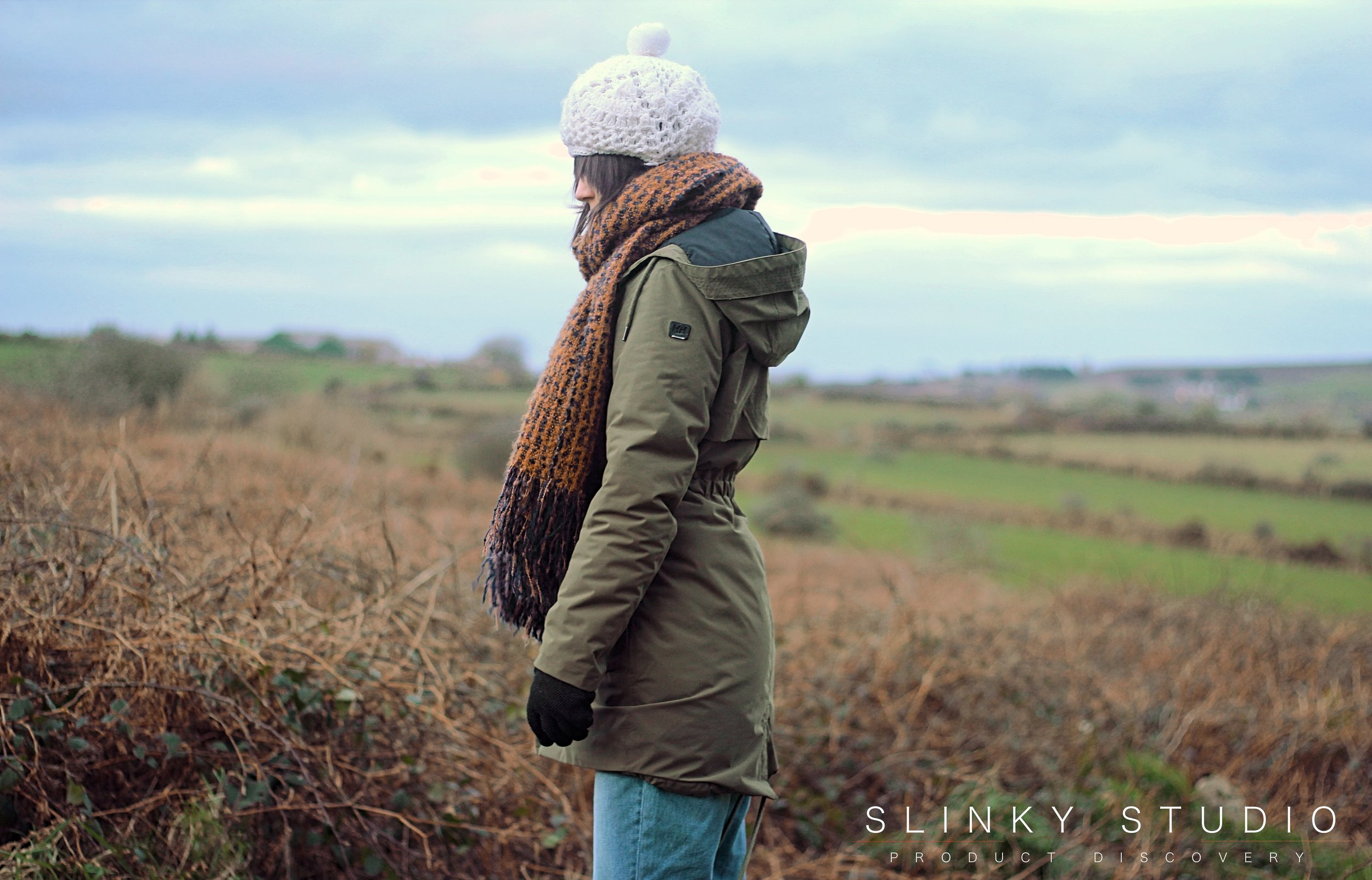 Helly Hansen Boyne Parka Ivy Green Side Profile View in Cornwall Countryside