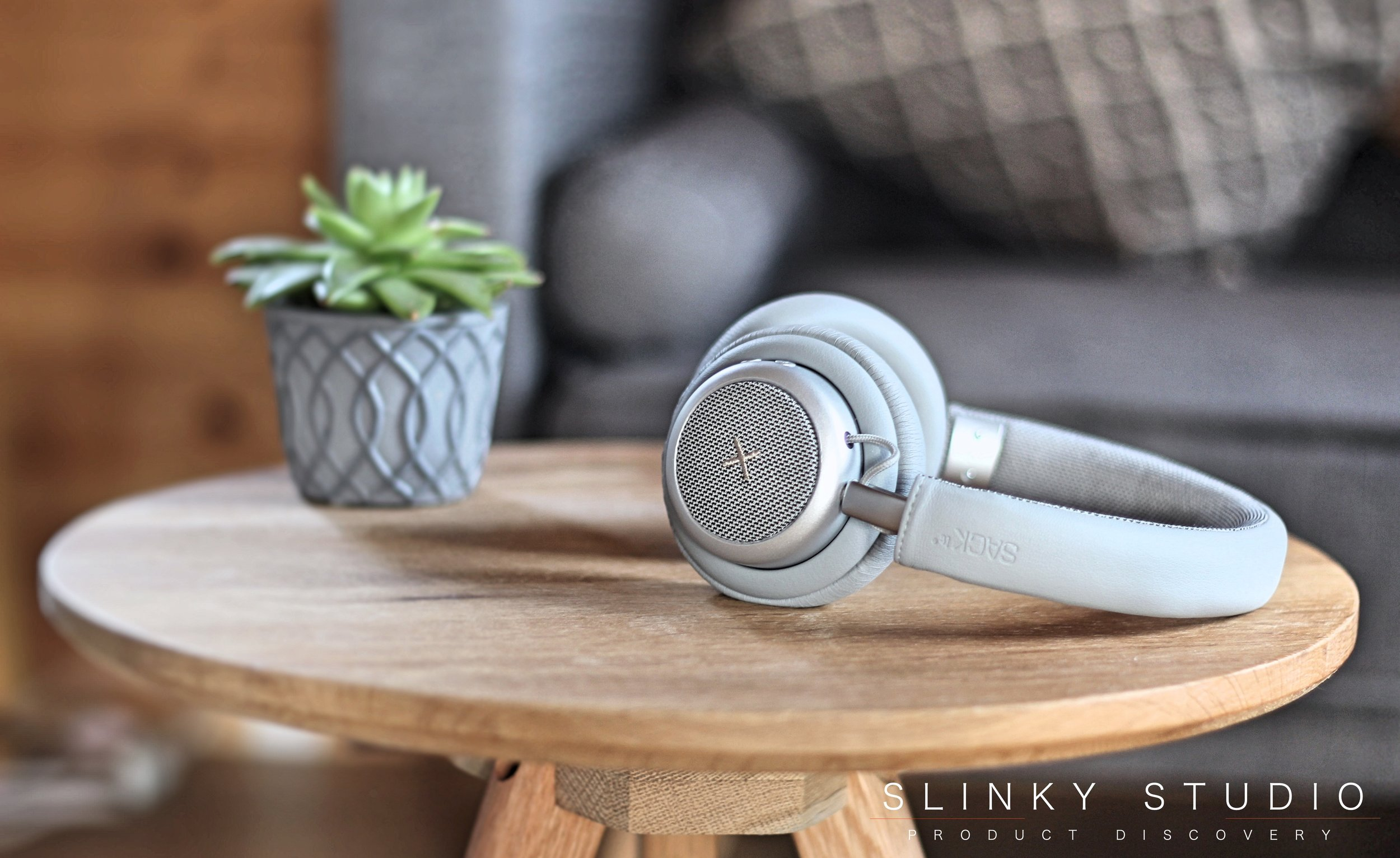 SACKit TOUCHit Headphones Silver Wooden Table Next to Succulent.jpg