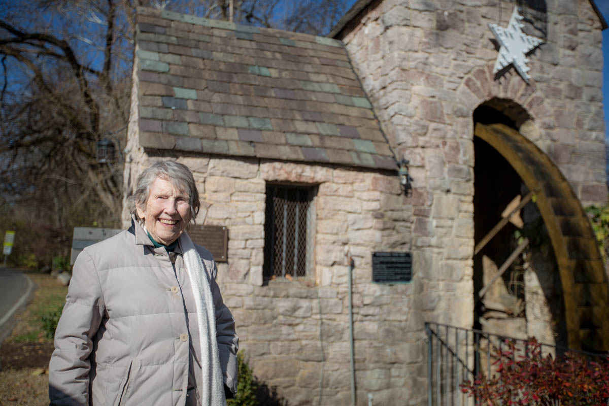 Nona, standing at the historic Westmoreland waterwheel on Sherwood Drive (Dec. 2016).