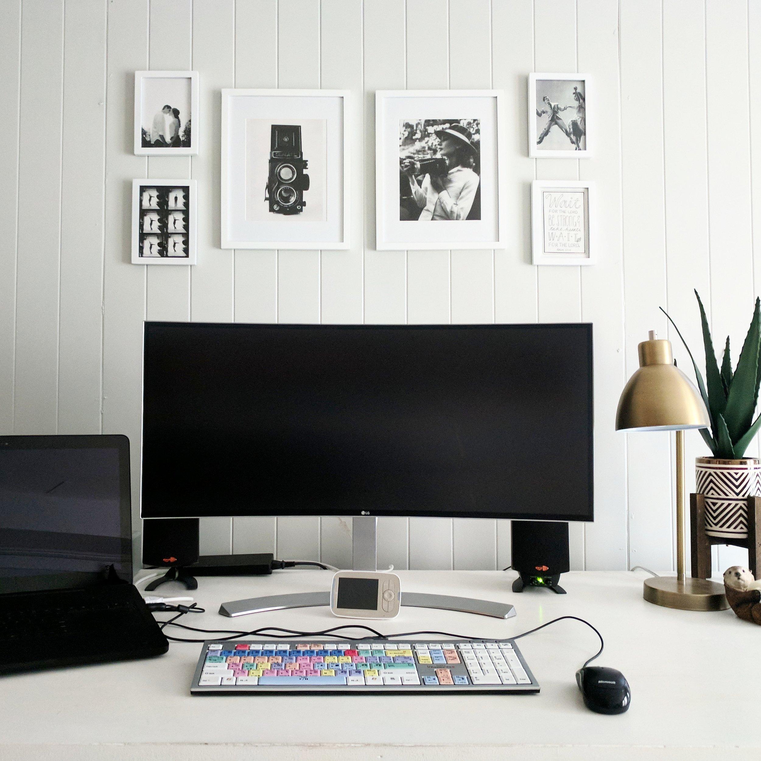 "My desk setup - 34"" curved ultrawide monitor, editing keyboard, and Razer Blade Pro."