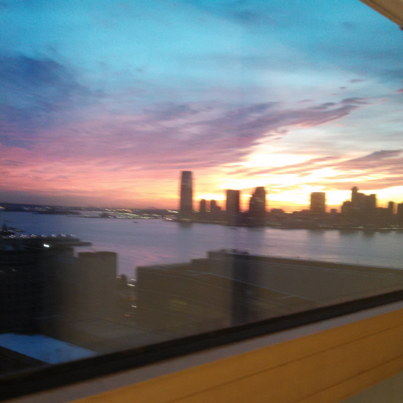 A blurry sun setting over Jersey, from my office window.