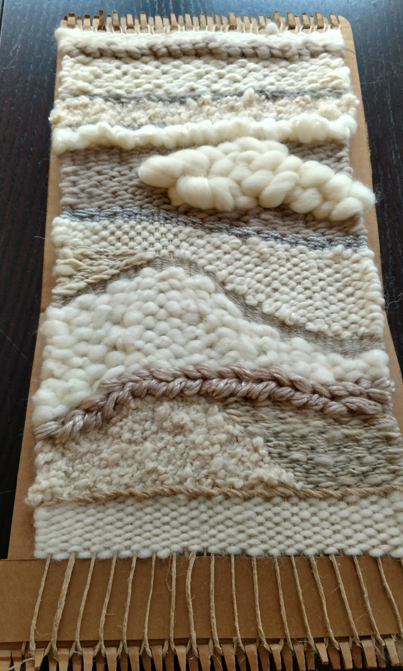 a wall hanging done with a jute twine warp