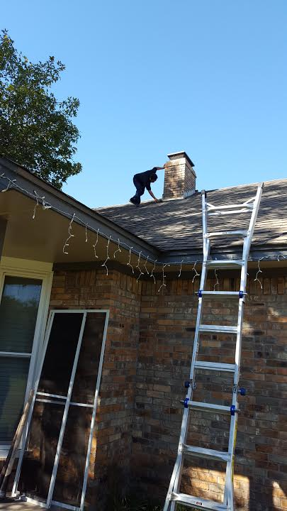Here is Diego inspecting the flashing around the chimney. Inspecting flashing around all roof penetrations is part of our routine when performing a roof inspection .