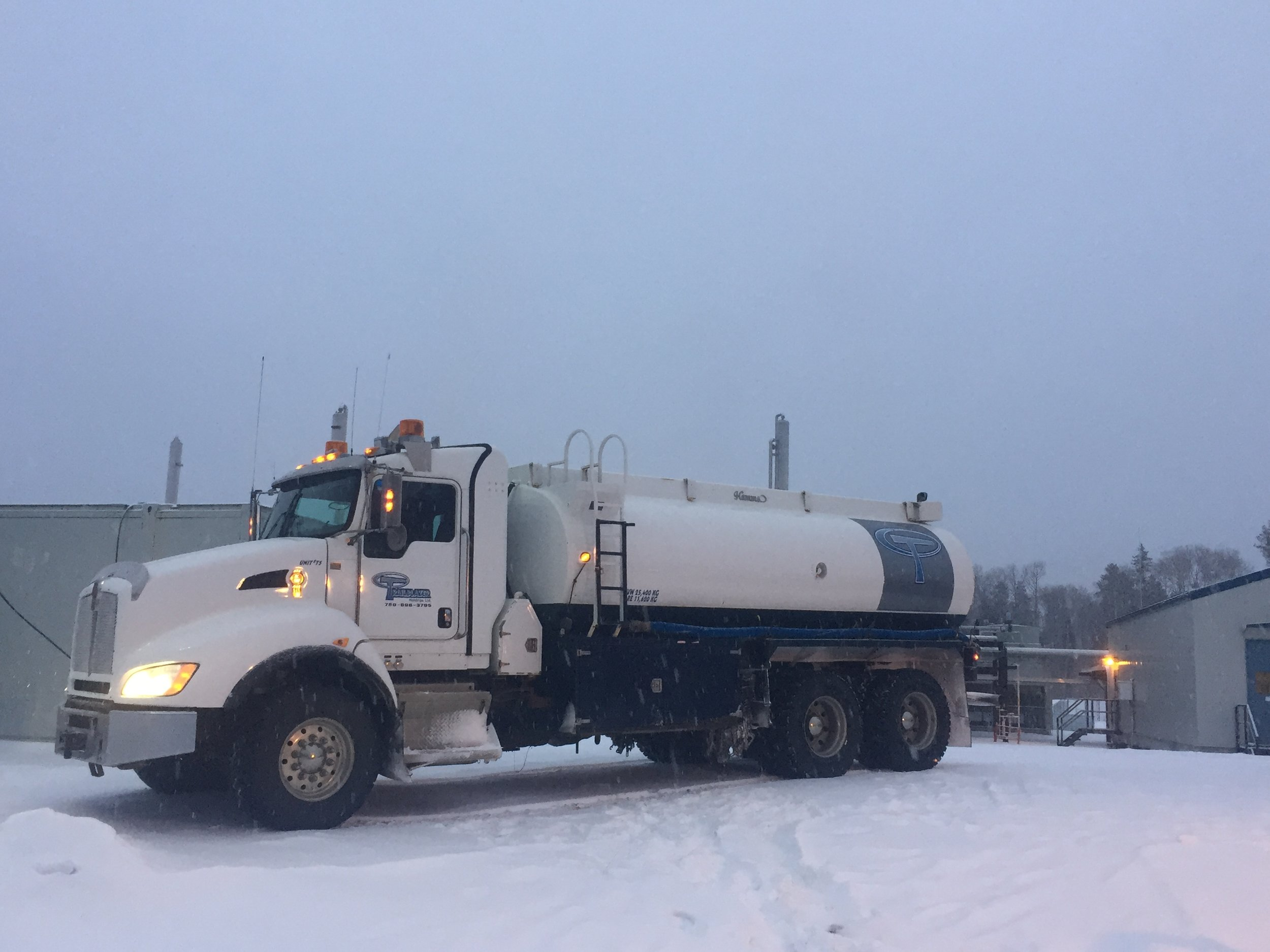 "2013 Kenworth T440 Tandem Axle Tank Truck. The Tank has a Potable Liner, a 3"" Pump, and a 100' Hose Reel with 2"" Hose"