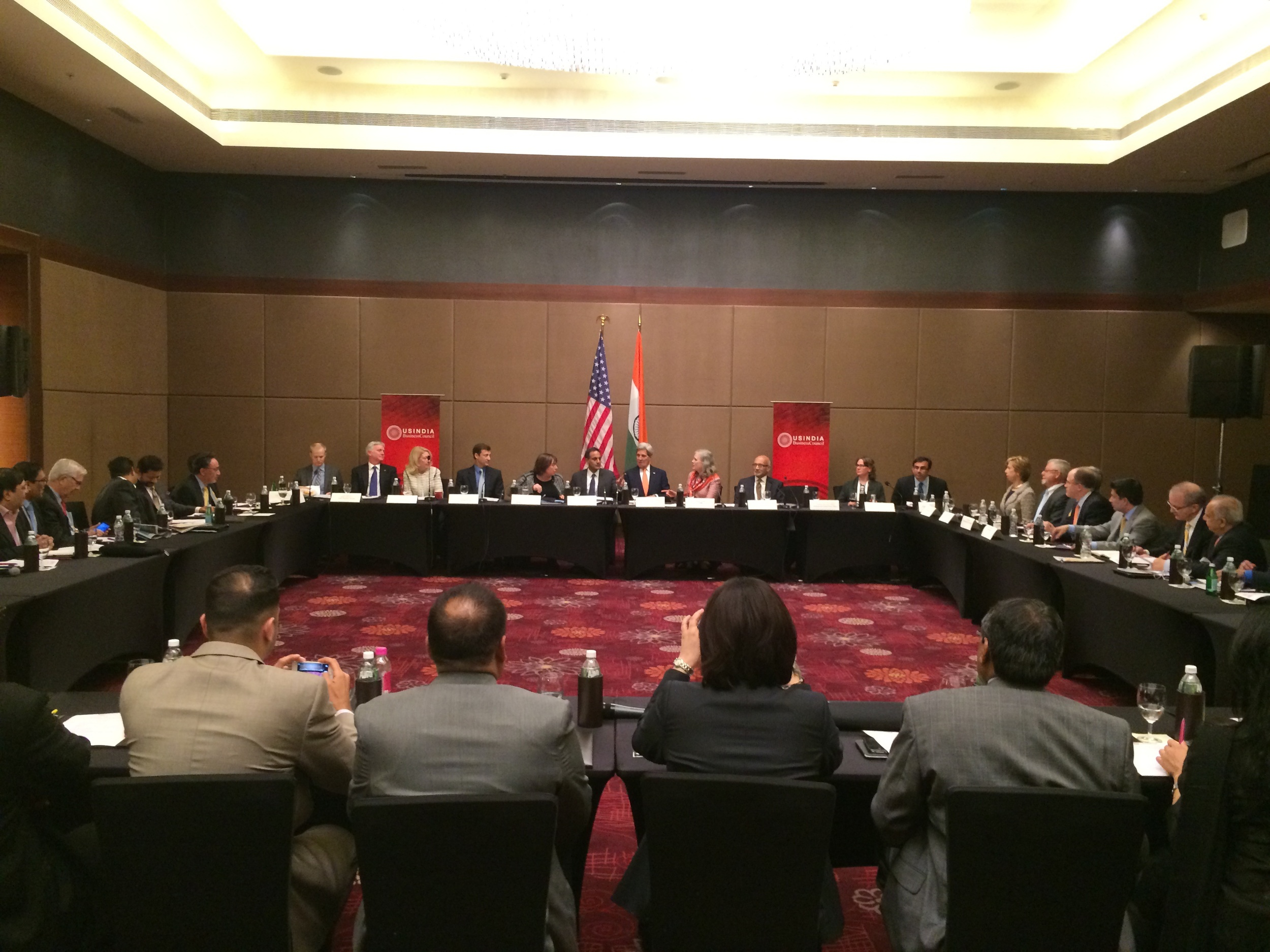 Suresh Nichani, Vice Chairman of RootCorp (extreme left), on the round table with Honorable John Kerry  , United States Secretary of State (center), in Ahmedabad, India on US-India Business and Economic Policies.