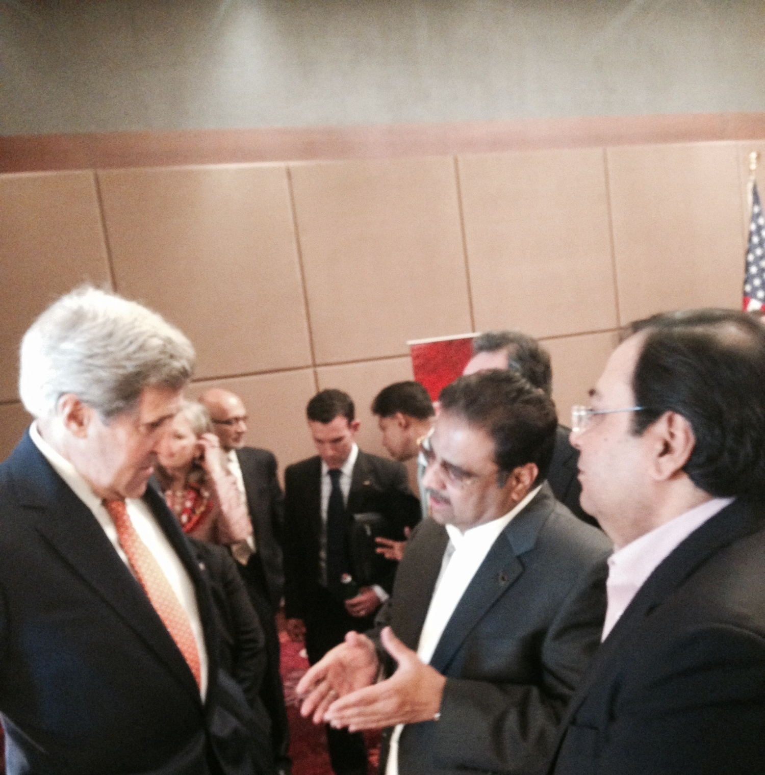 Suresh Nichani, Vice Chairman of RootCorp (right)with Honorable John Kerry, United States Secretary of State (left), and Mr. Danny Gaekwad (middle).