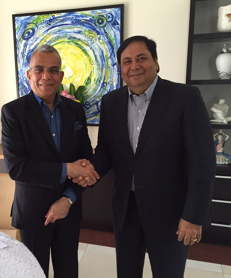 Mr. PNC Menon (Independent Director) & Mr. Suresh Nichani (Vice Chairman & Fund Director) shaking hands.
