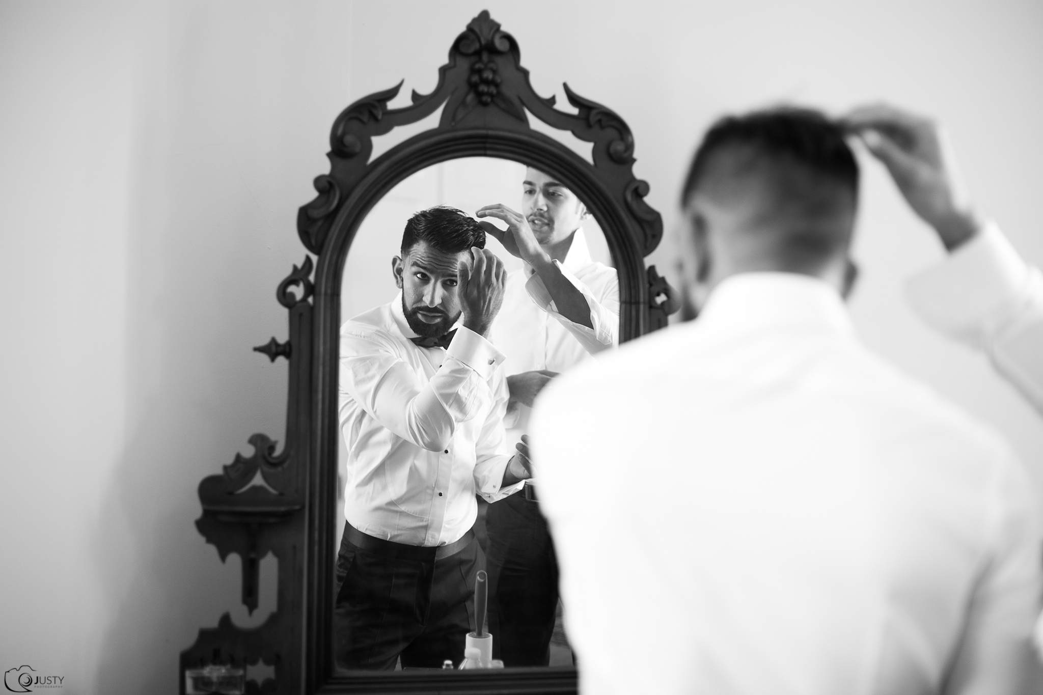 Groom getting ready at Strong Mansion Wedding