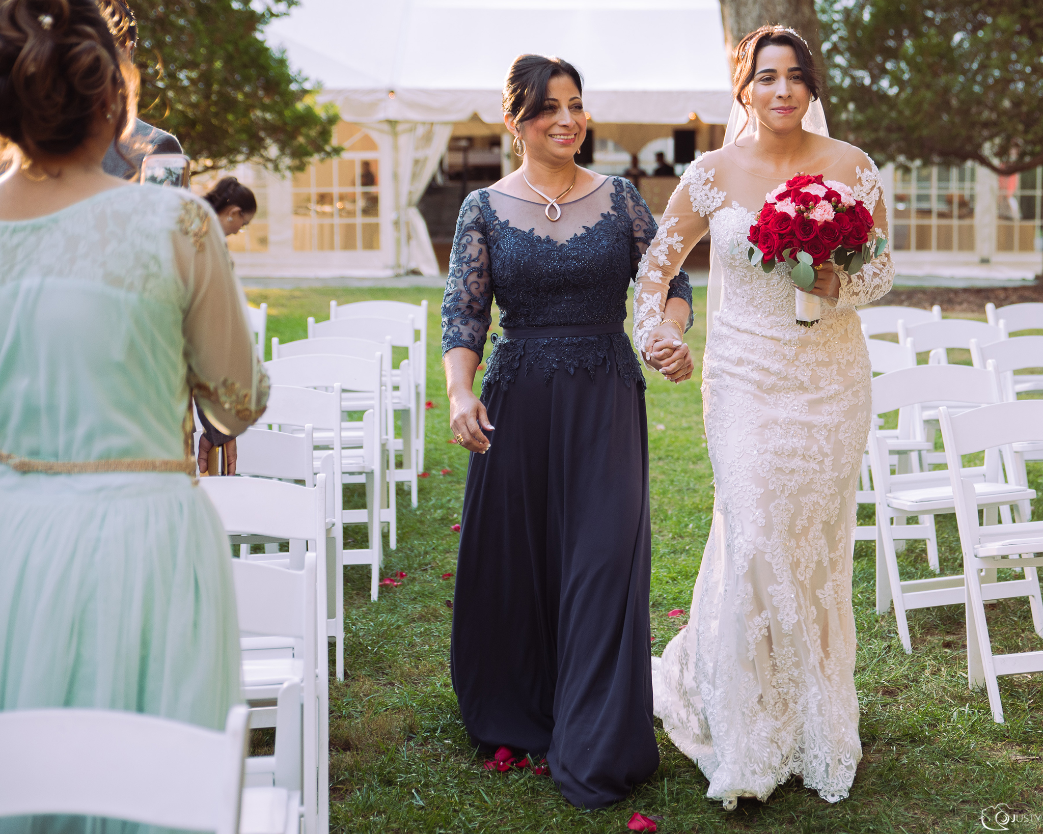 Bride and her mom walking down the isle -Strong Mansion Wedding