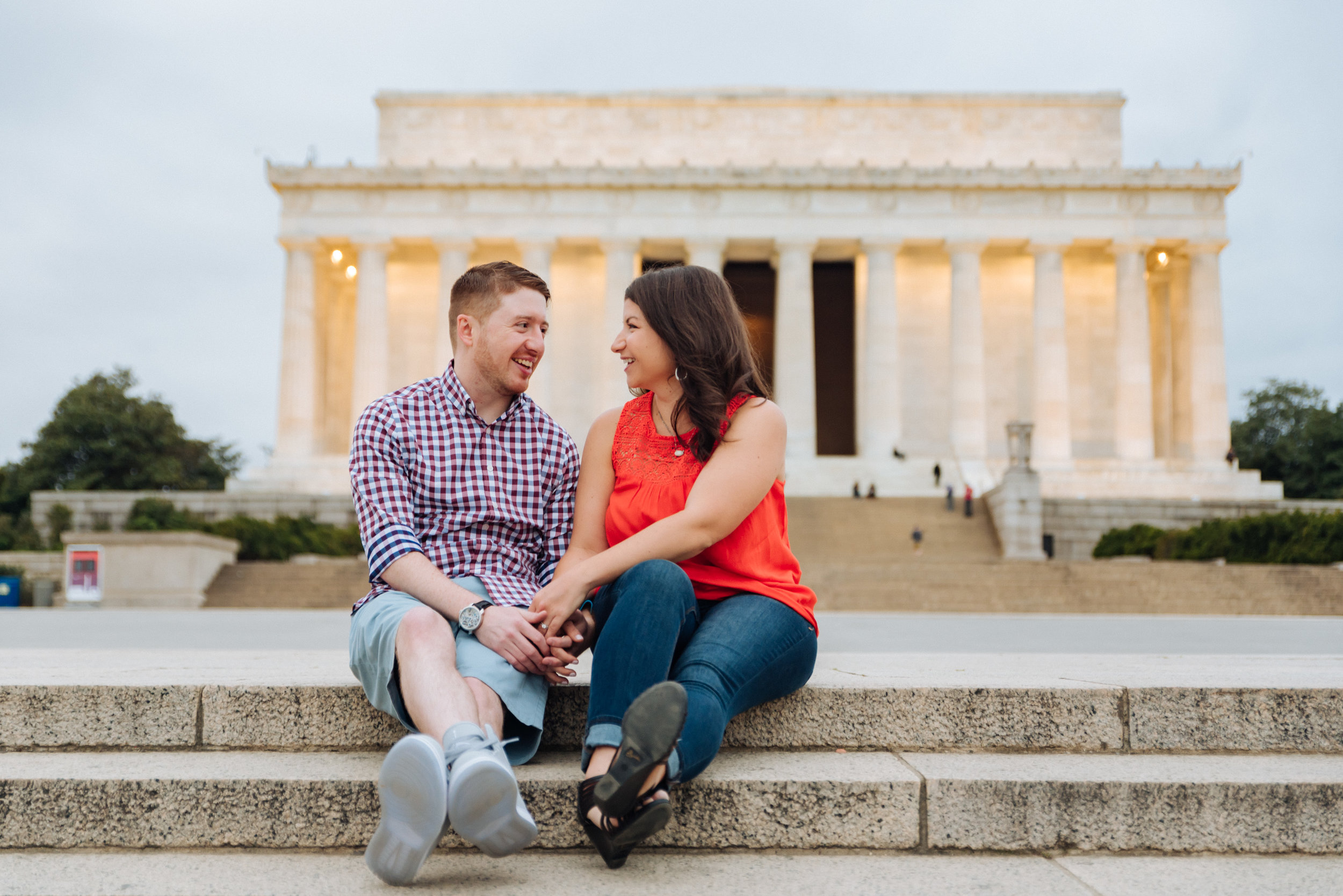 ATHENS IS WHERE OUR STORY BEGINS….  Lauren and Ryan met in September 2007 while attending the one and only Ohio University in Athens. Exactly where did they meet? As surprising as it may seem, Lauren and Ryan met in class.  On a Friday afternoon, Lauren and Ryan were both attending their sociology class. On this particular day, students in the class were going to have a debate. Lauren and Ryan only observed, but, unbeknownst to each other, both felt strongly about what was being said. Lauren, being the introvert she is, remained quiet in her seat about her reaction to the debate. Ryan, on the other hand, being outspoken and the extrovert he is, raised his hand, stood up in the lecture hall, and volunteered a piece of his mind. It was enough to make Lauren notice, so she turned around from her nerdy second-row seat (Ryan sat in the back row of the lecture hall, of course) to see who this person was. And what did Lauren see? She saw someone with moppy red hair, skater shoes, gym shorts, and a hoodie… but about as short in stature as Lauren herself. Who WAS this guy? Lauren had to find out.  Class finally ended, and Lauren hung back a little so she would pass ways with this interesting (and loud…) red-headed guy. It was at this point Lauren and Ryan met, and struck up a conversation about what they just saw in class. They ended up carrying the conversation all of the way back to OU's Front Four dorms, where they both lived.  Is this the part where Ryan asked for Lauren's number, or vice versa? Actually, no. Lauren and Ryan didn't talk or see each other again... until a few months later.