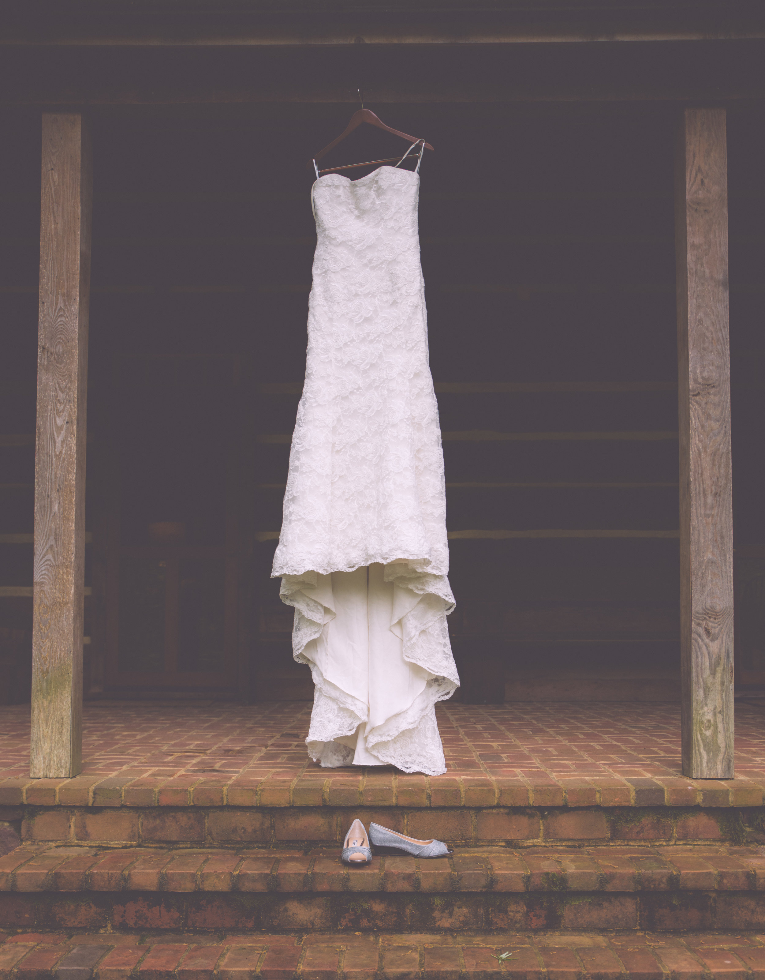 Brides Dress and shoes hanging outside