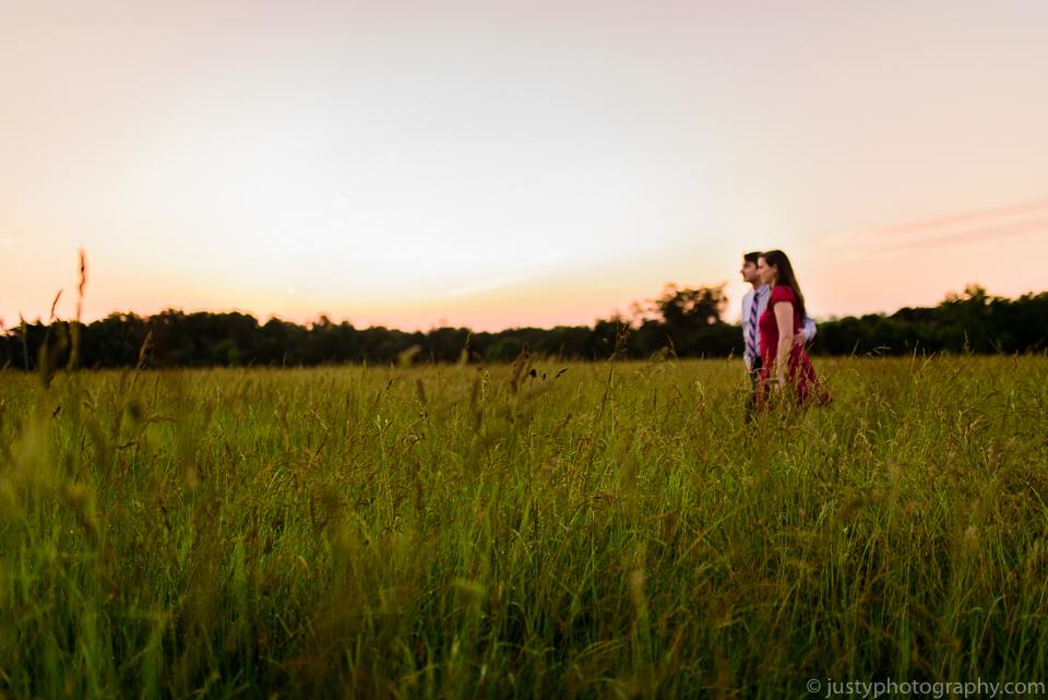 Beautiful engagement couple walking in field. Washington, DC engagement photographer.