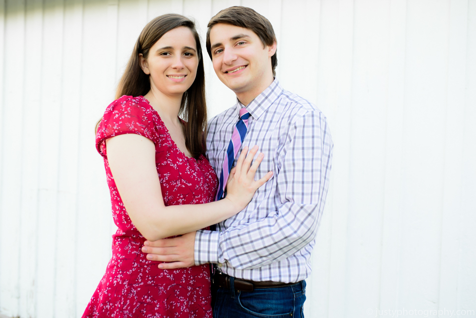 Cute couple during engagement photo session with Washington DC photographers at Justy Photography.