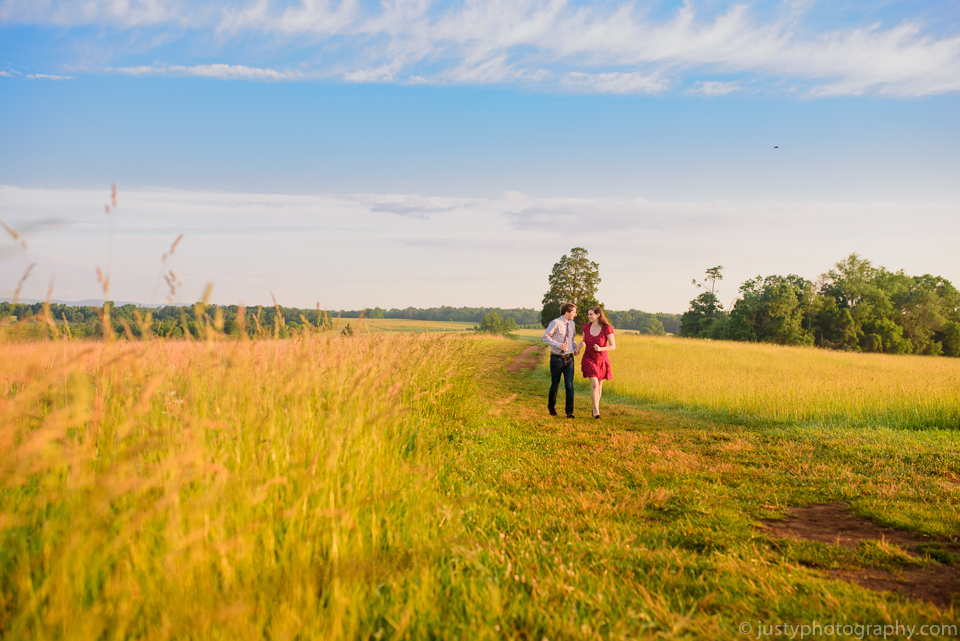 Engagement couple in beautiful field during sunset.
