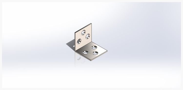 A copy of the holes is added to the opposite face of the bracket in one step with a mirroring command.