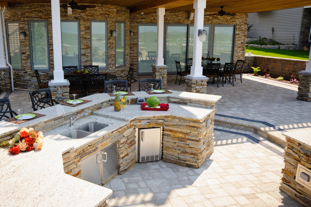 Esch Landscaping - Outdoor Living - Full Outdoor Kitchen with Bar for Entertaining .jpg