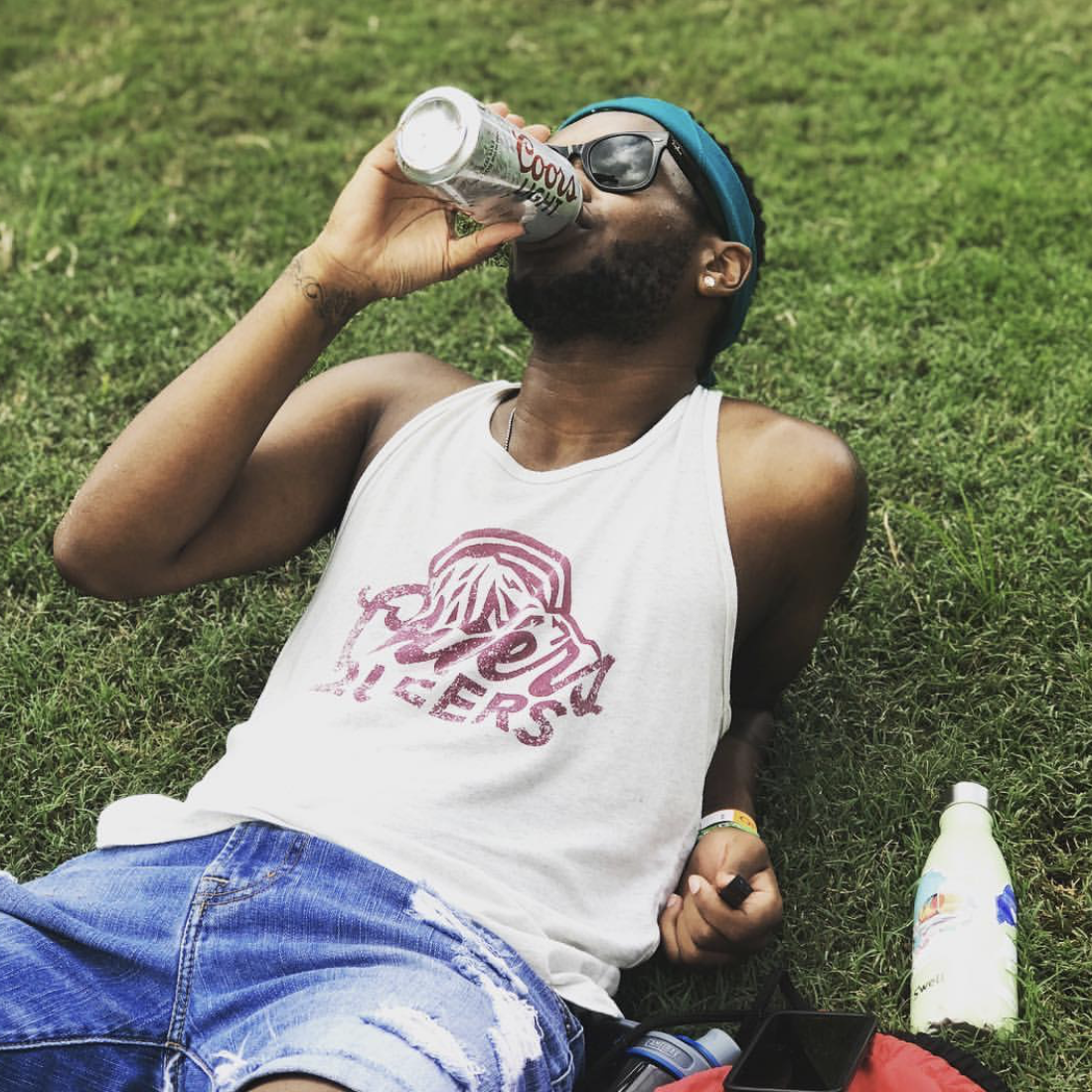 Spencer (they/them) - Sippin' a cold beer in our Cheers Queers Tank!