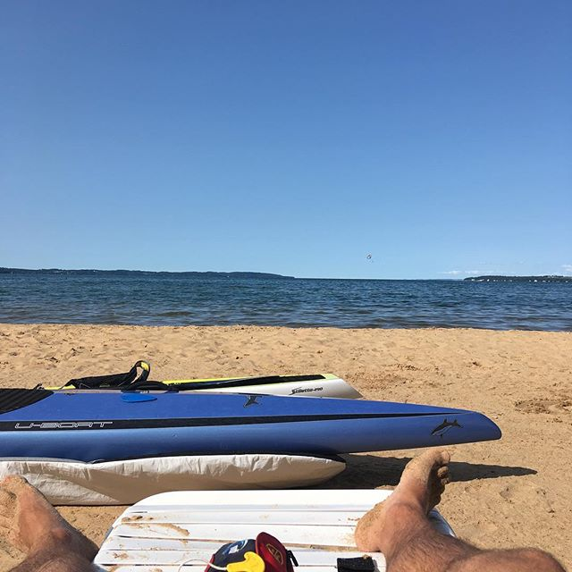 Water in Traverse City is looking choice! Conditions should be favorable tomorrow for the #suptc race.