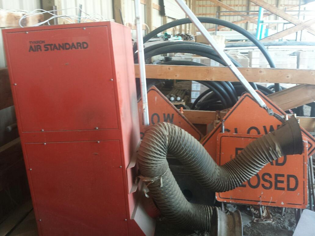Shop welder exhaust vacuum