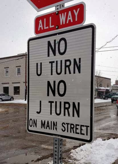 A sign indicating that J-turns aren't allowed. In Alberta, J-turns are always illegal. Signs indicating J-turns are illegal are not required.