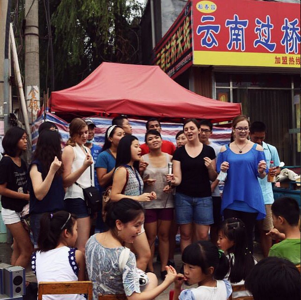 DukeEngage Zhuhai-ers performing in Beijing's Banta migrant village as part of a musical/art exchange