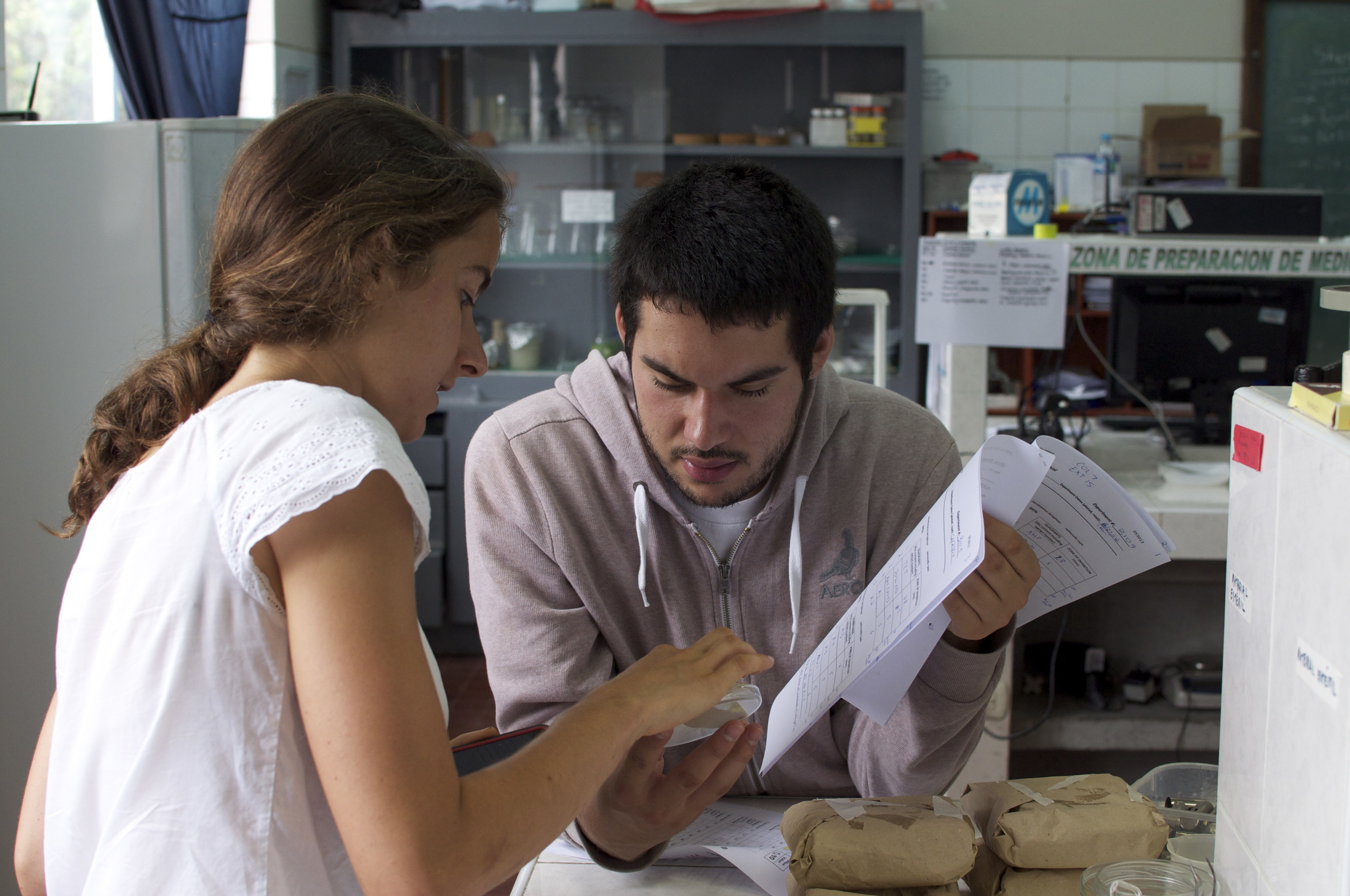 Summer 2014 - MHIRT student Abel Arellano works with with Carolyn Gigot, a Harvard student working in the UNT lab, to see if Peruvian medicinal plants have antibacterial properties.