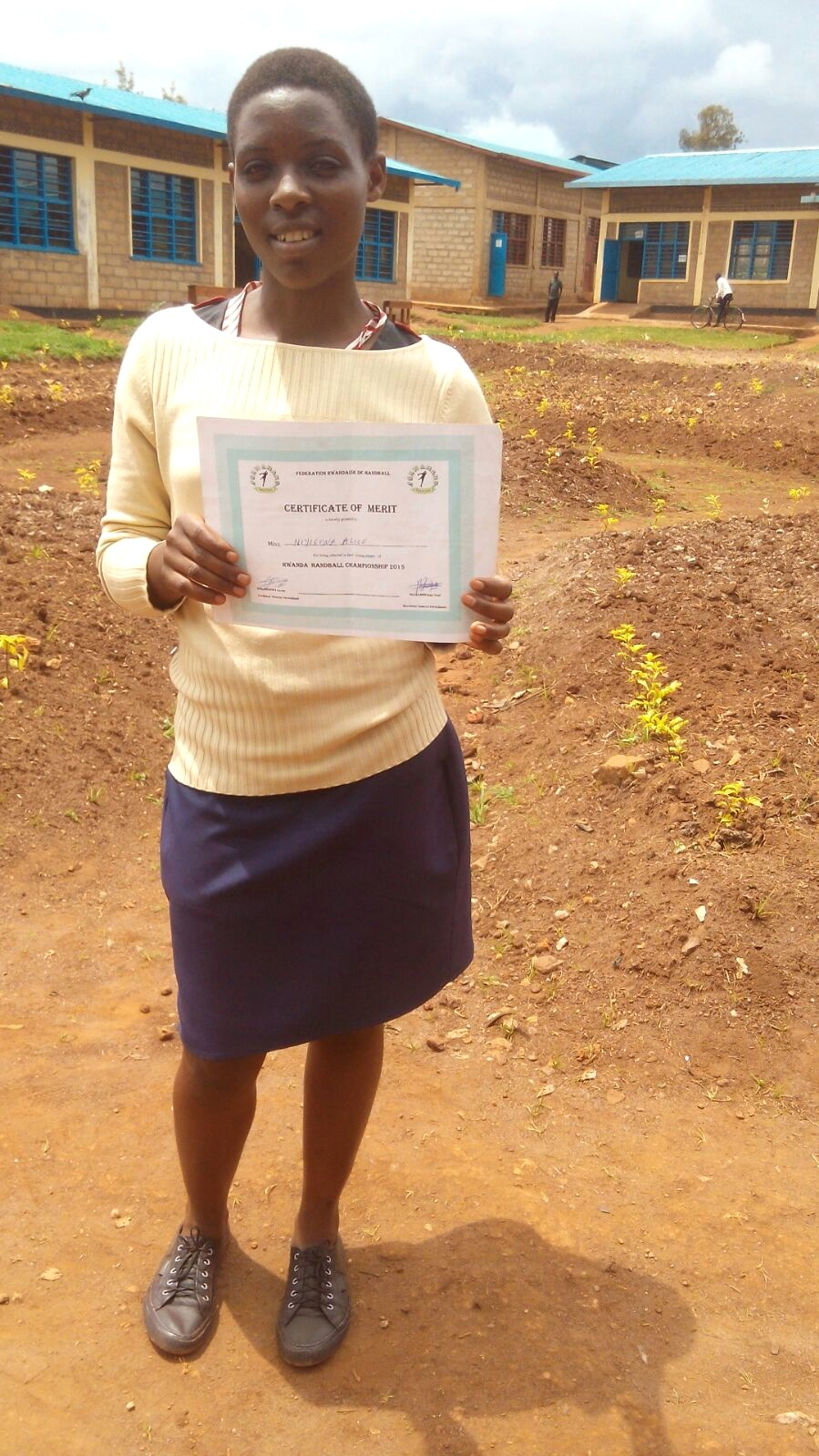 Alice holding her certificate