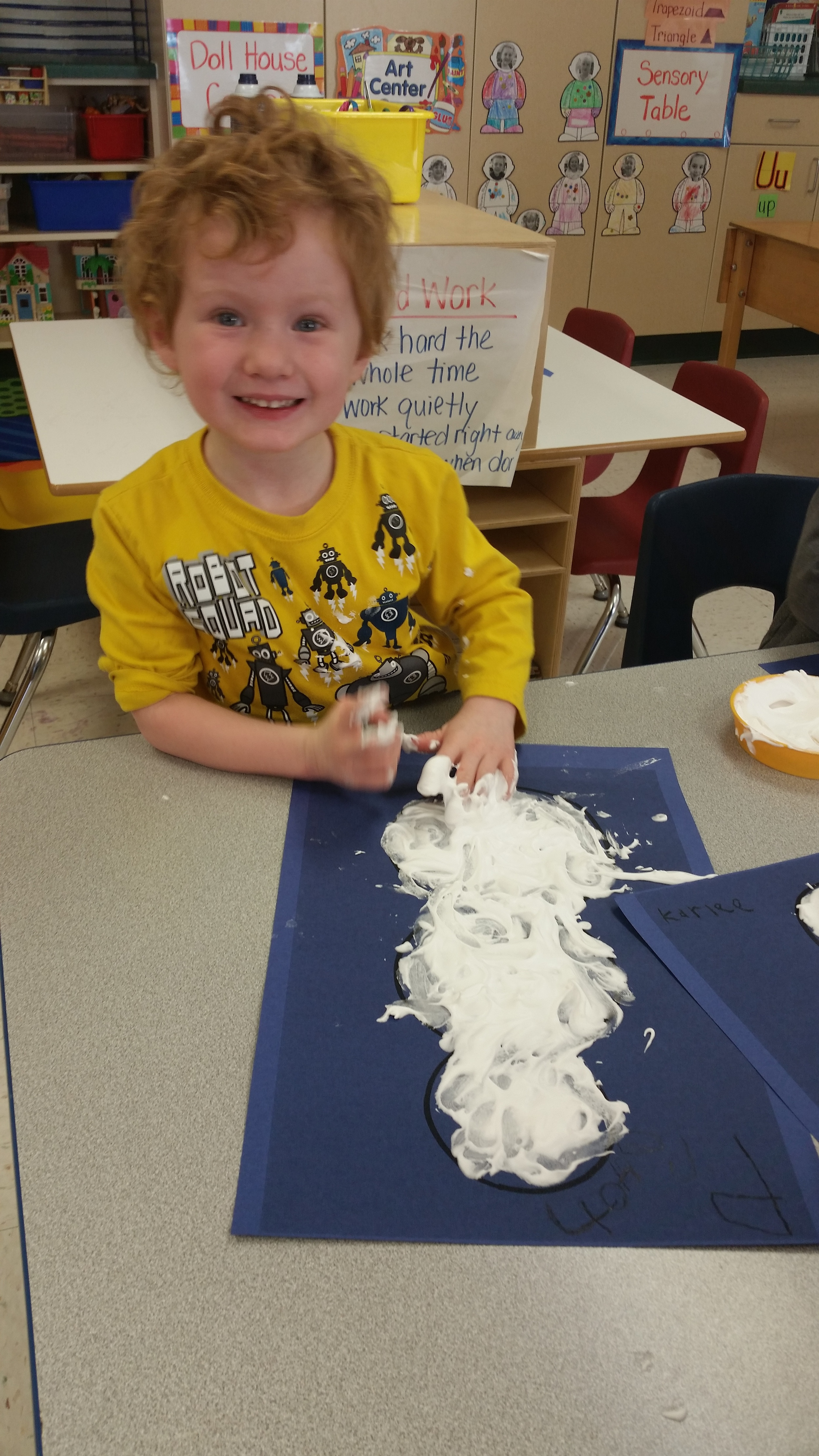 finger painting with a mixture of shaving cream and glue