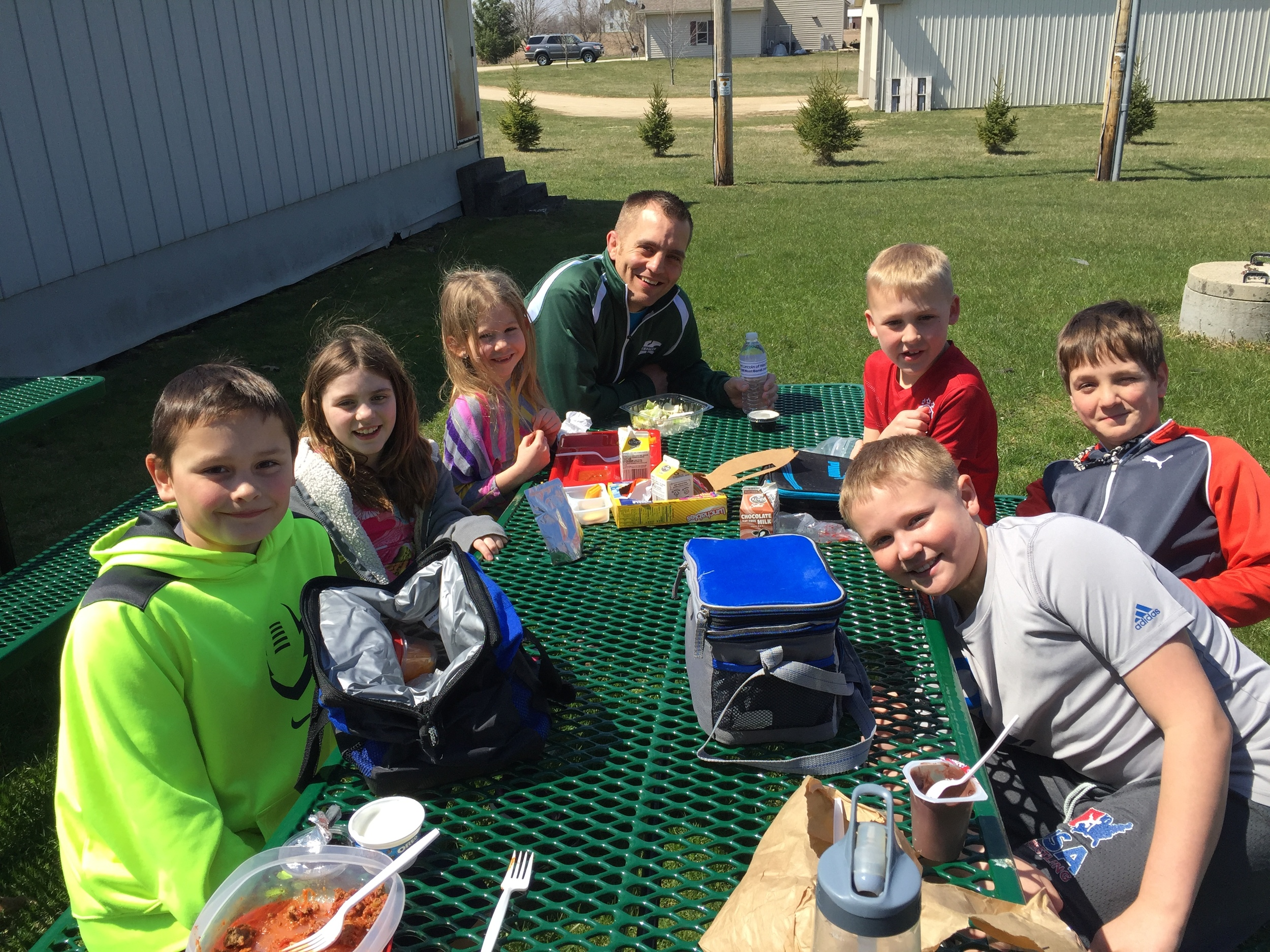 Mr. Dziedzic and the winners of this month's Respect Award eating lunch together outside today. Classroom teachers chose one student per grade level (K-5) to receive this award.