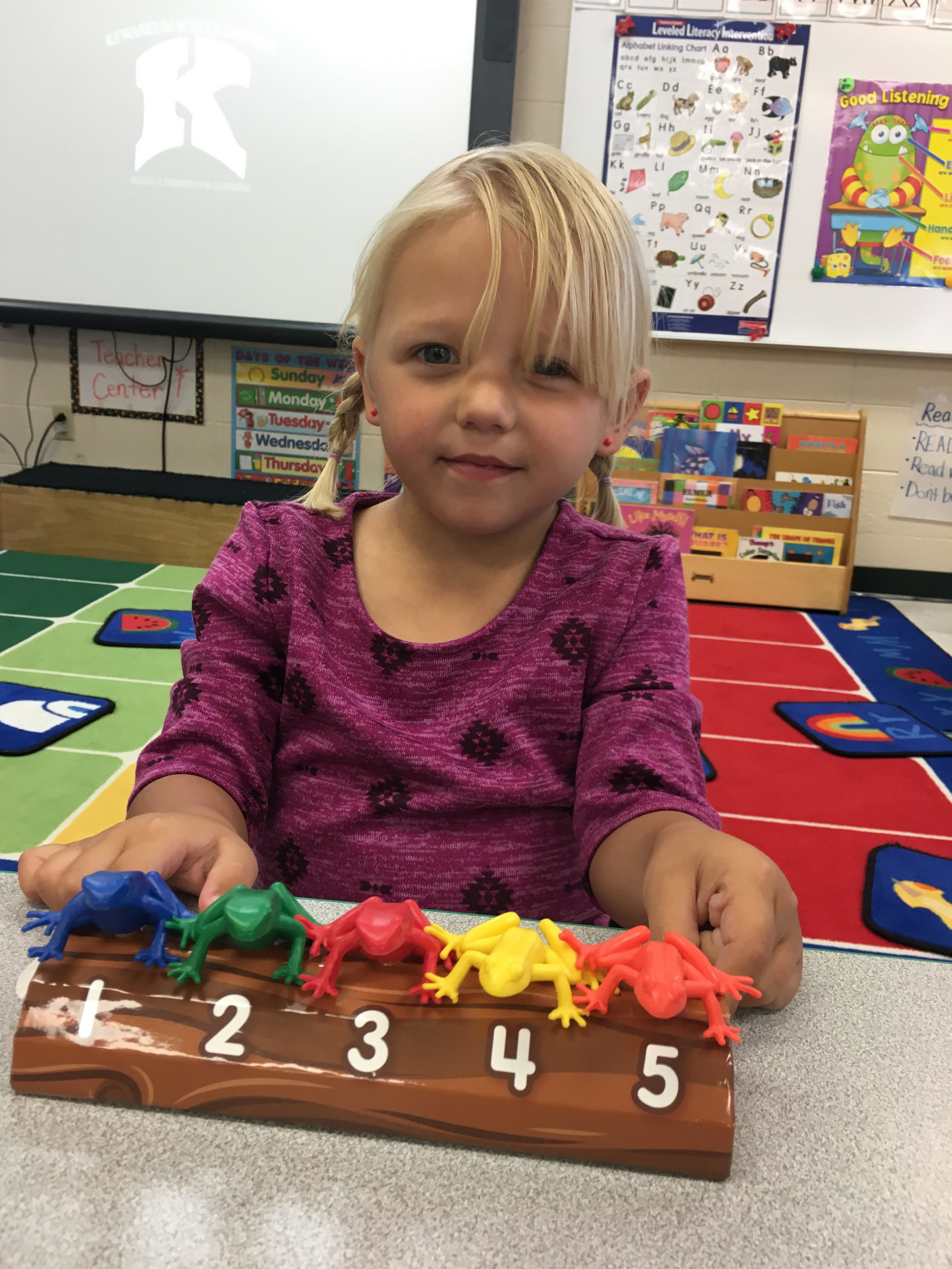 practicing counting with frogs on a log