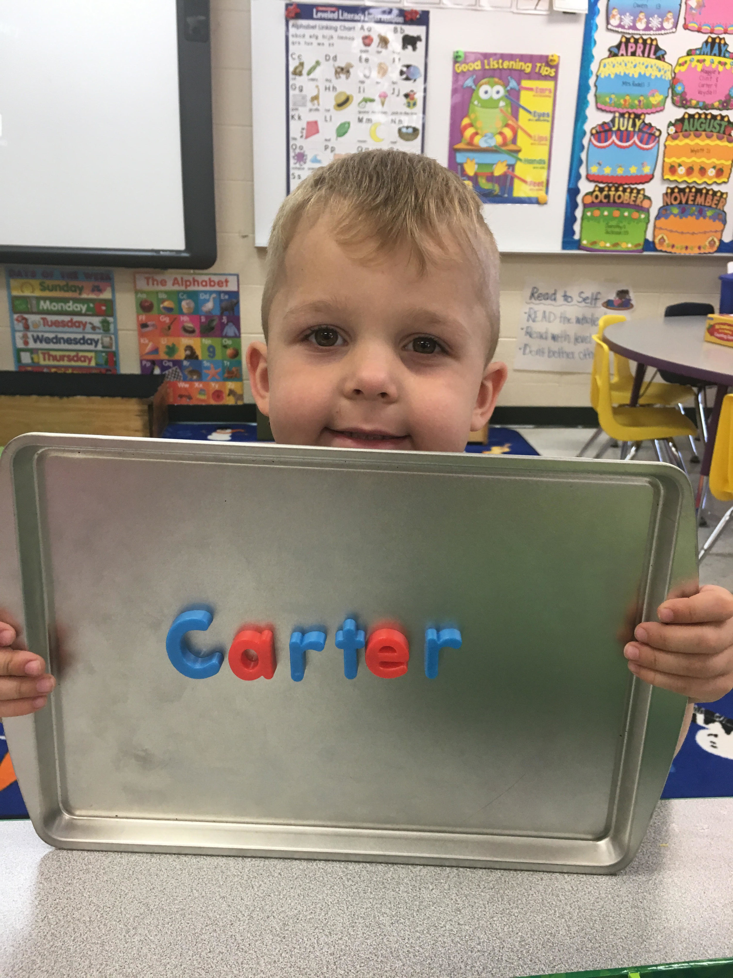 using magnets to spell his name
