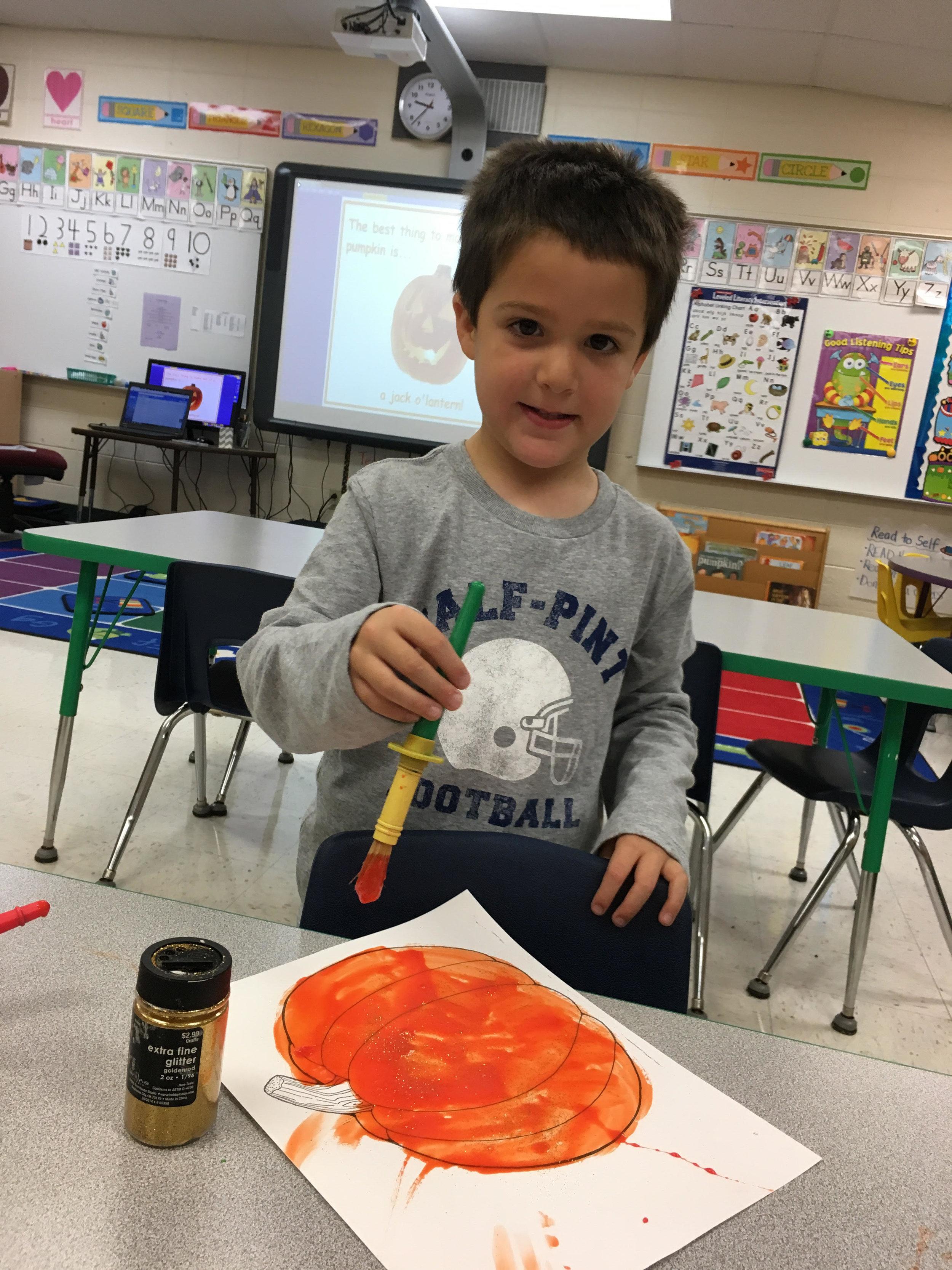 Painting pumpkins with sweetened condensed milk