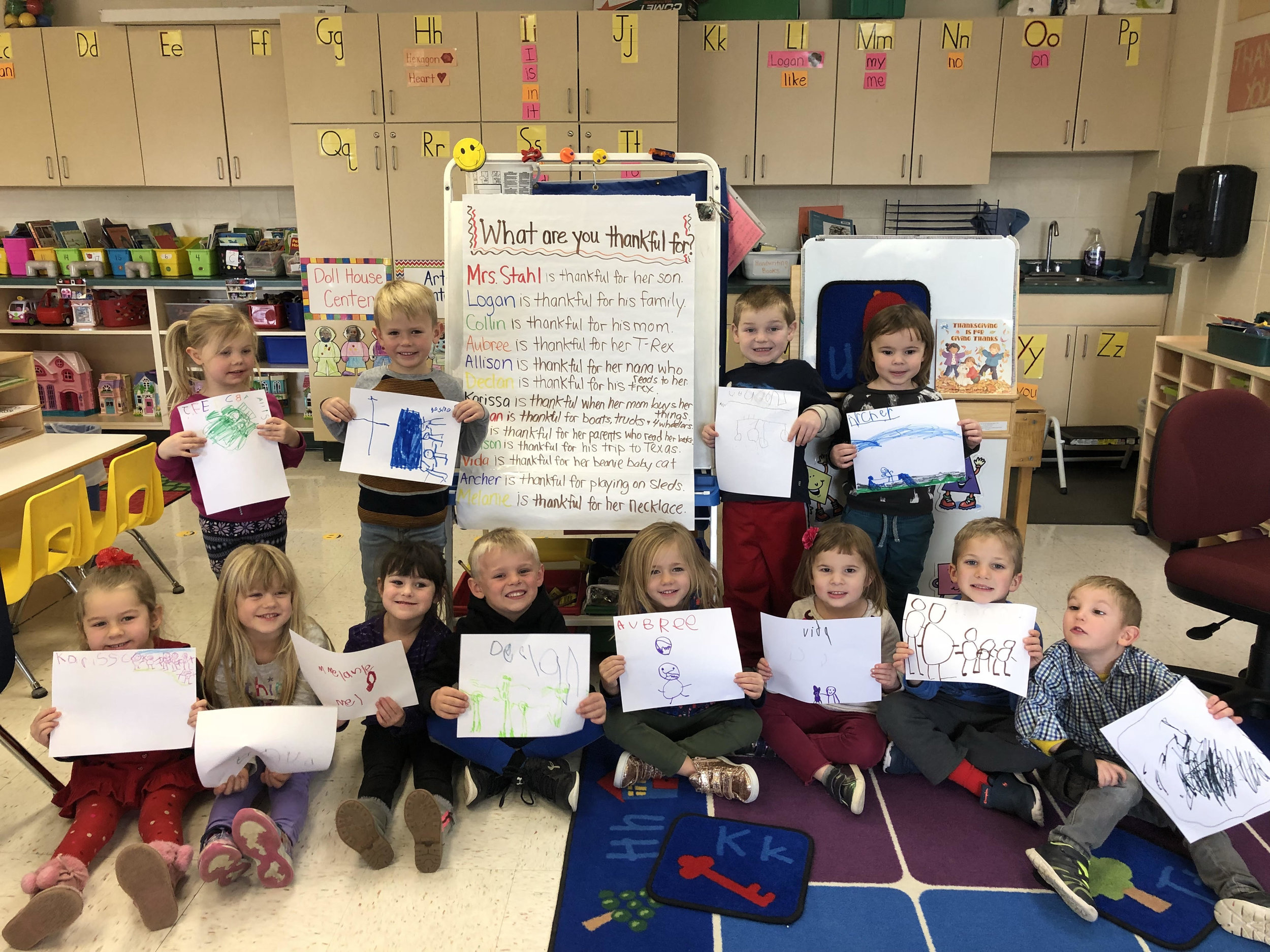 students drew a picture to show something they are each thankful for